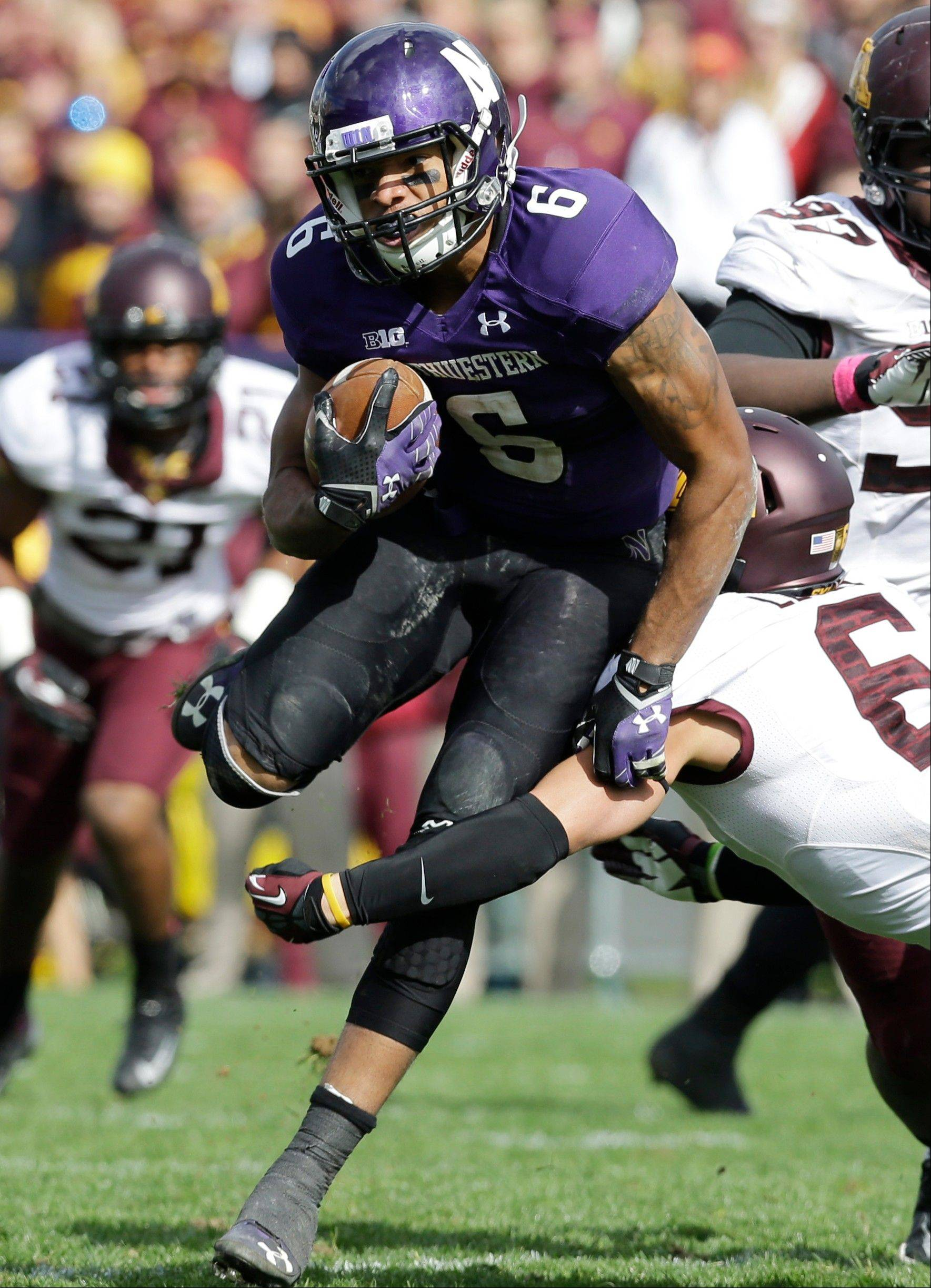 Northwestern wide receiver Tony Jones is tackled by Minnesota linebacker Damien Wilson during the second half last Saturday in Evanston. Northwestern has won four of the last five games against Iowa.