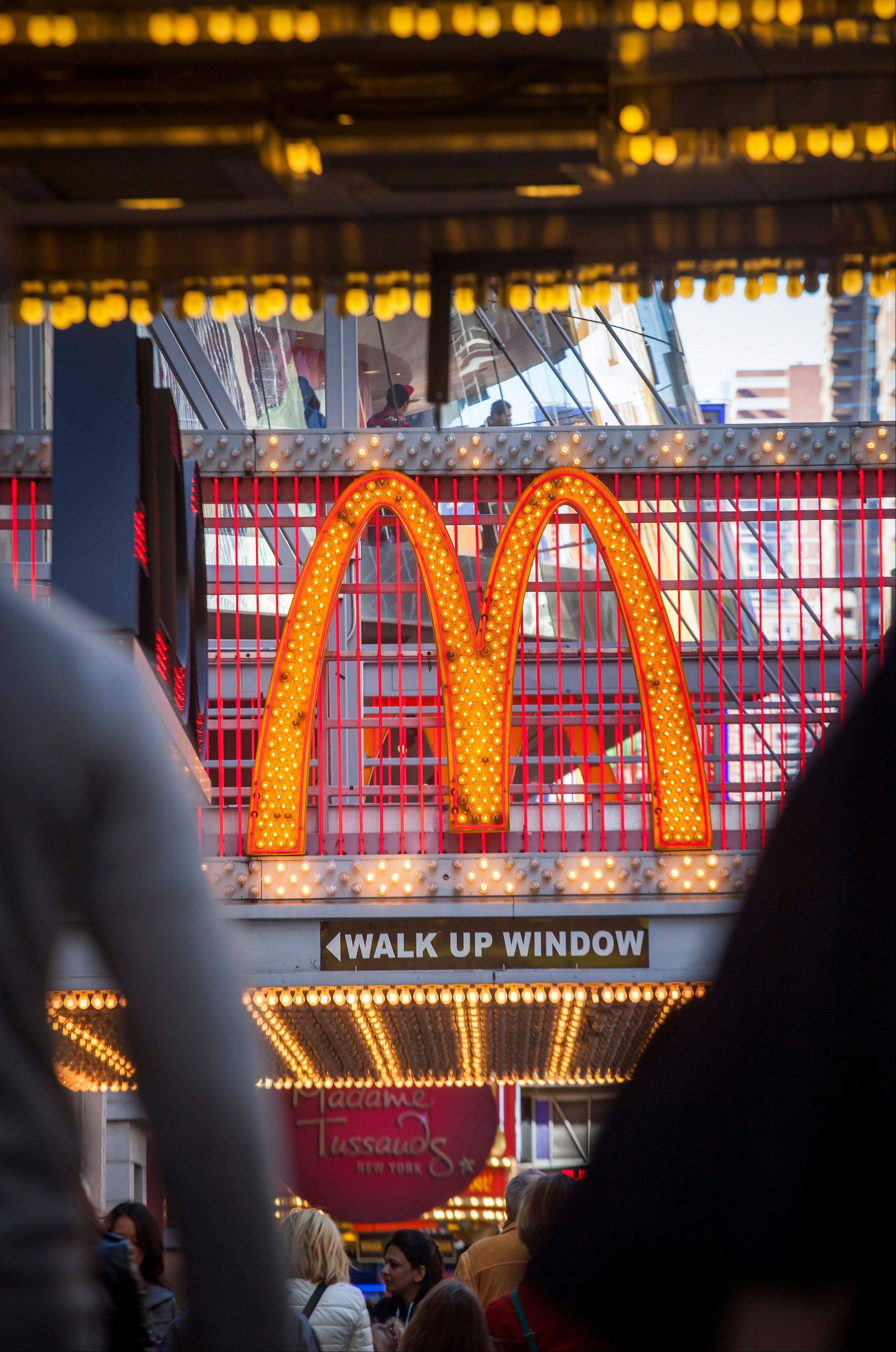 Pedestrians pass a McDonald's Corp. restaurant last Sunday on 42nd Street in Times Square in New York.