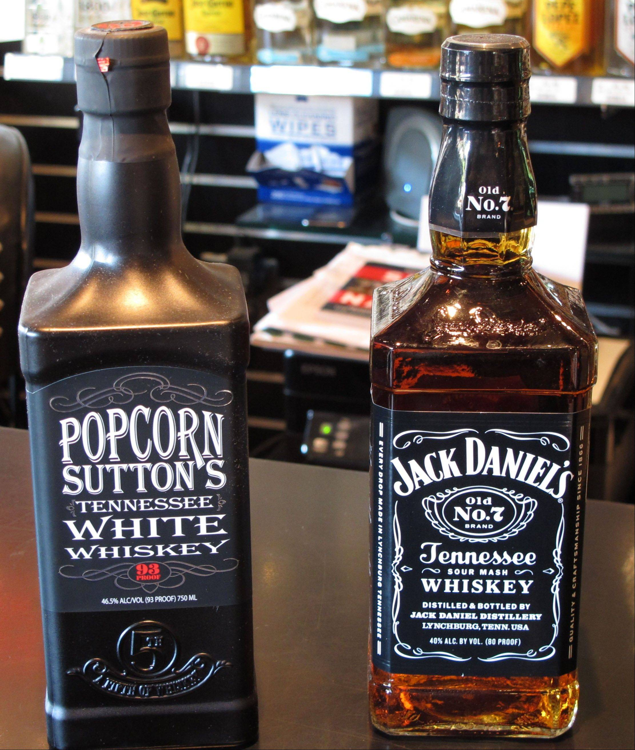Bottles of Popcorn Sutton's Tennessee White Whiskey and Jack Daniel's Tennessee whiskey sit side by side at a Louisville, Ky., liquor store.