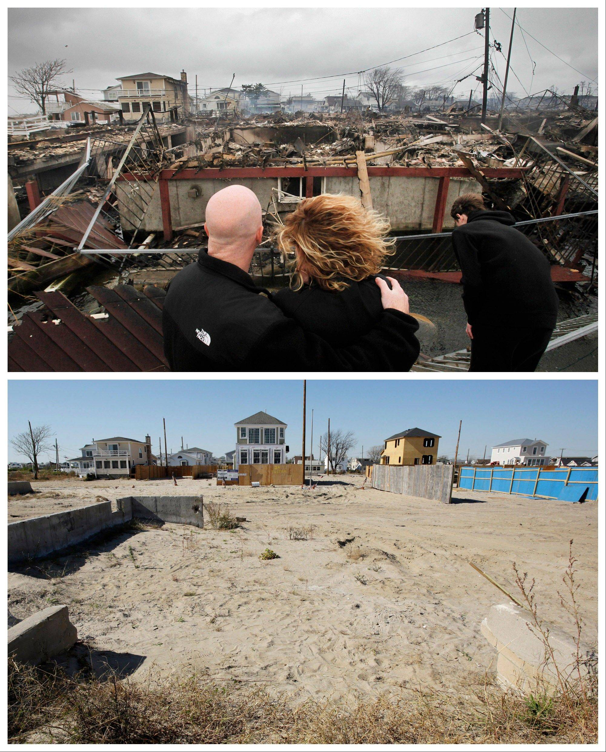This combination of Tuesday, Oct. 30, 2012 and Monday, Oct. 21, 2013 photos shows Robert Connolly and his wife Laura as they survey the remains of the home owned by her parents that burned to the ground during Superstorm Sandy.