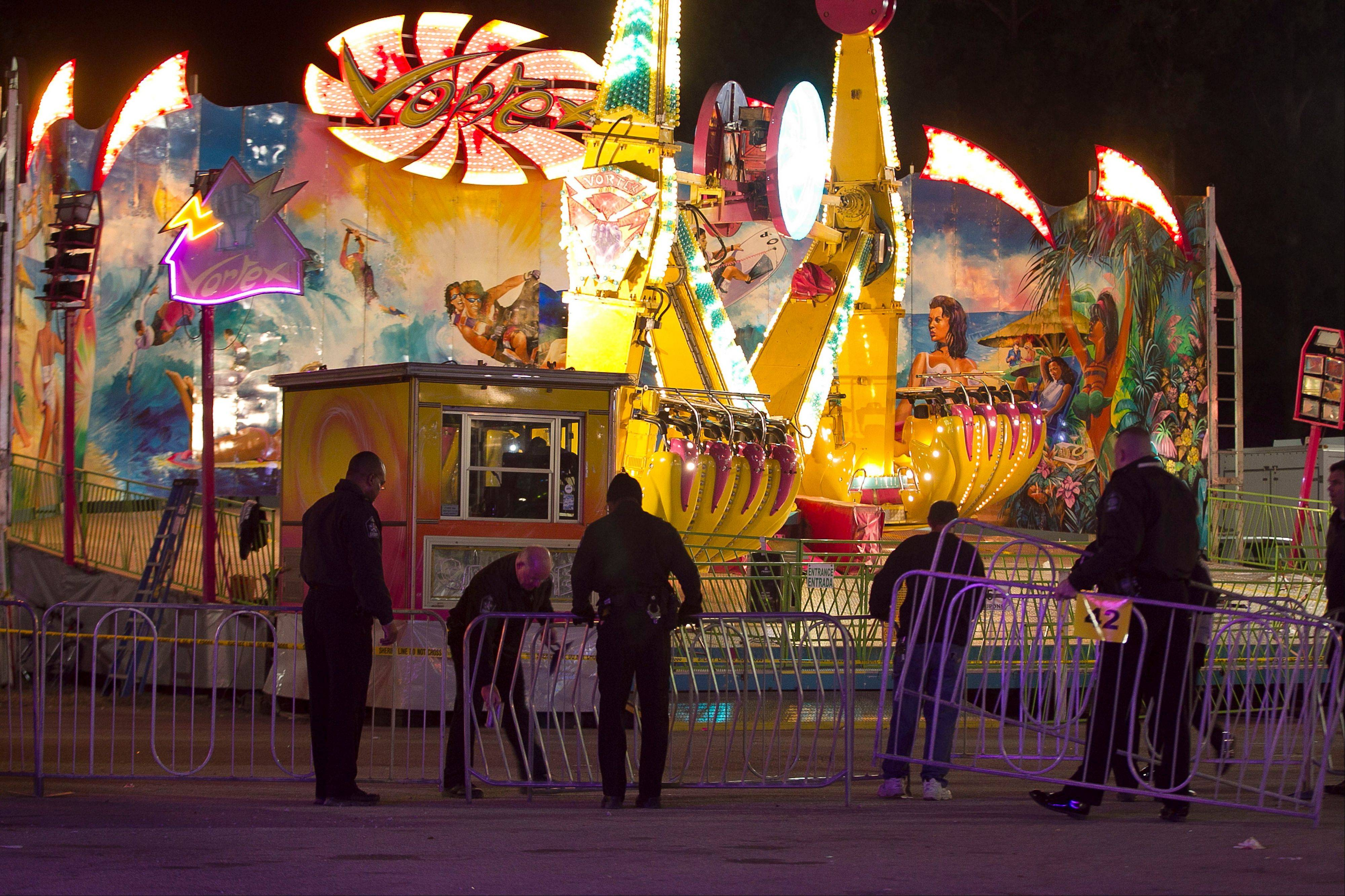 Fairgrounds Police secure a barricade around the Vortex after an accident closed the ride just after 9 p.m. on Thursday at the N.C. State Fair in Raleigh, N.C.