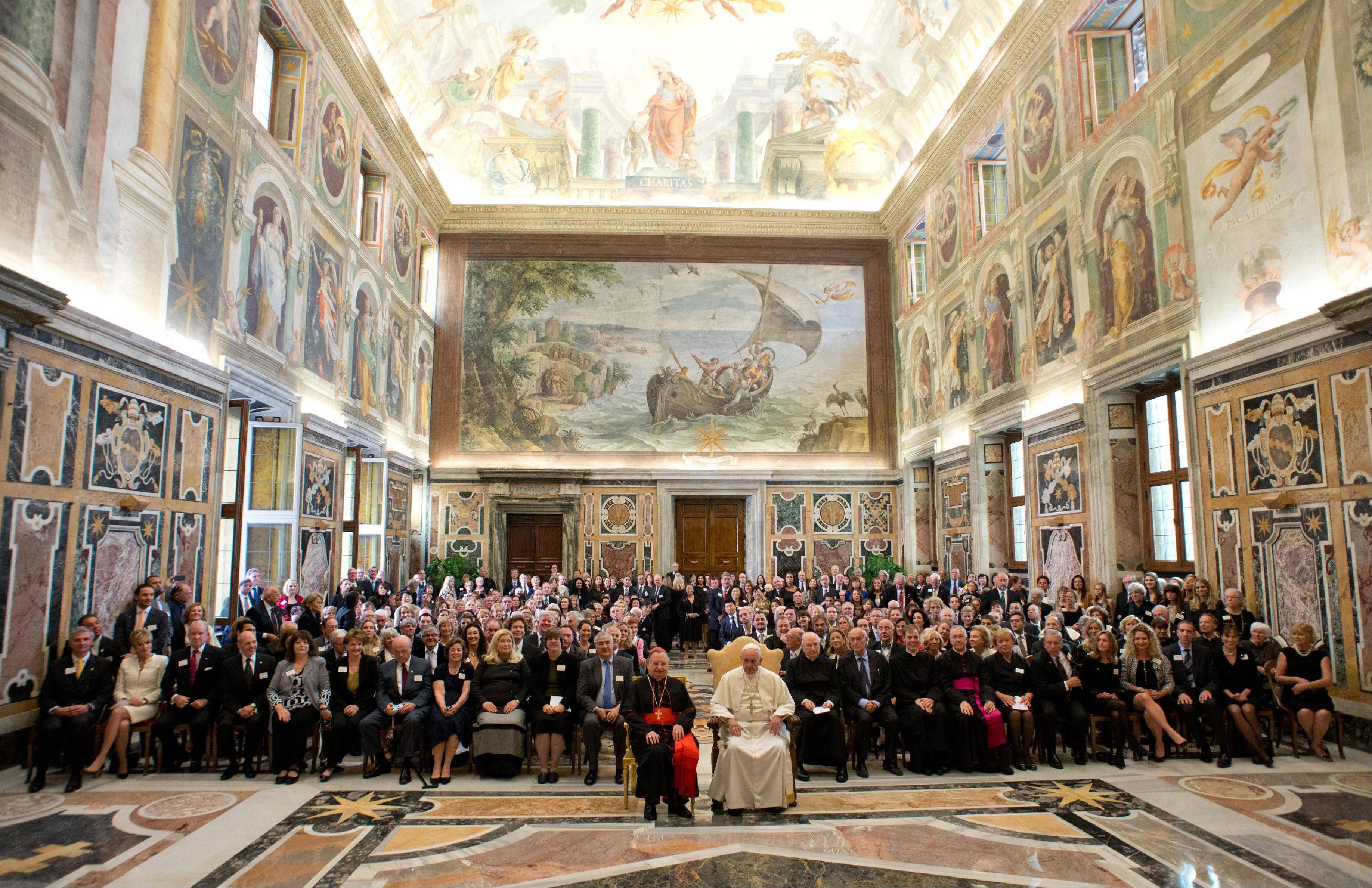 Pope Francis, in white at front, with the Patrons of the Arts of the Vatican Museum, a fundraising organization for restoring the Vatican's artistic treasures, on the occasion of their audience, at the Clementine Hall, at the Vatican.