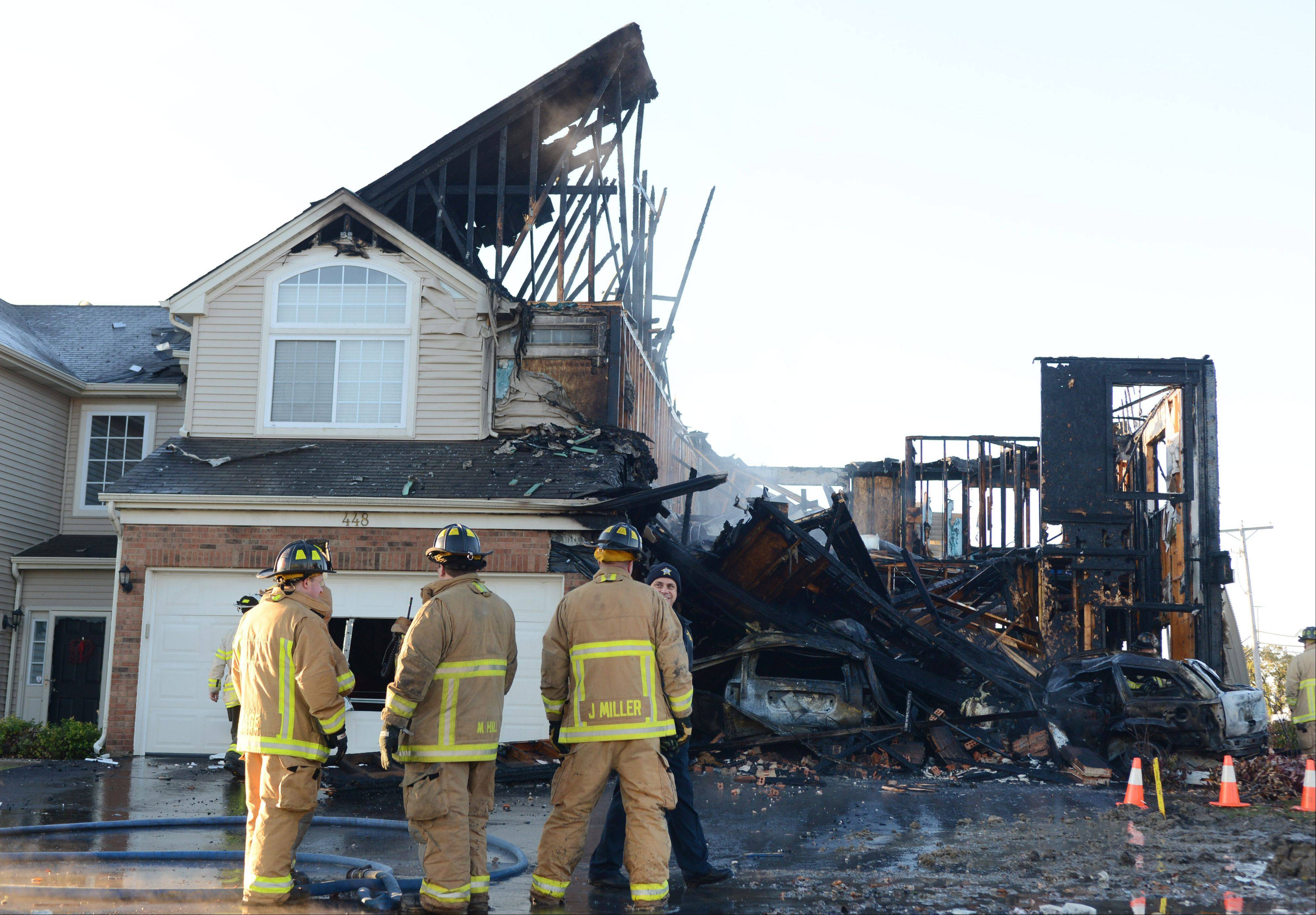 A Hainesville townhouse was destroyed by fire after a car crashed into it early Friday morning.