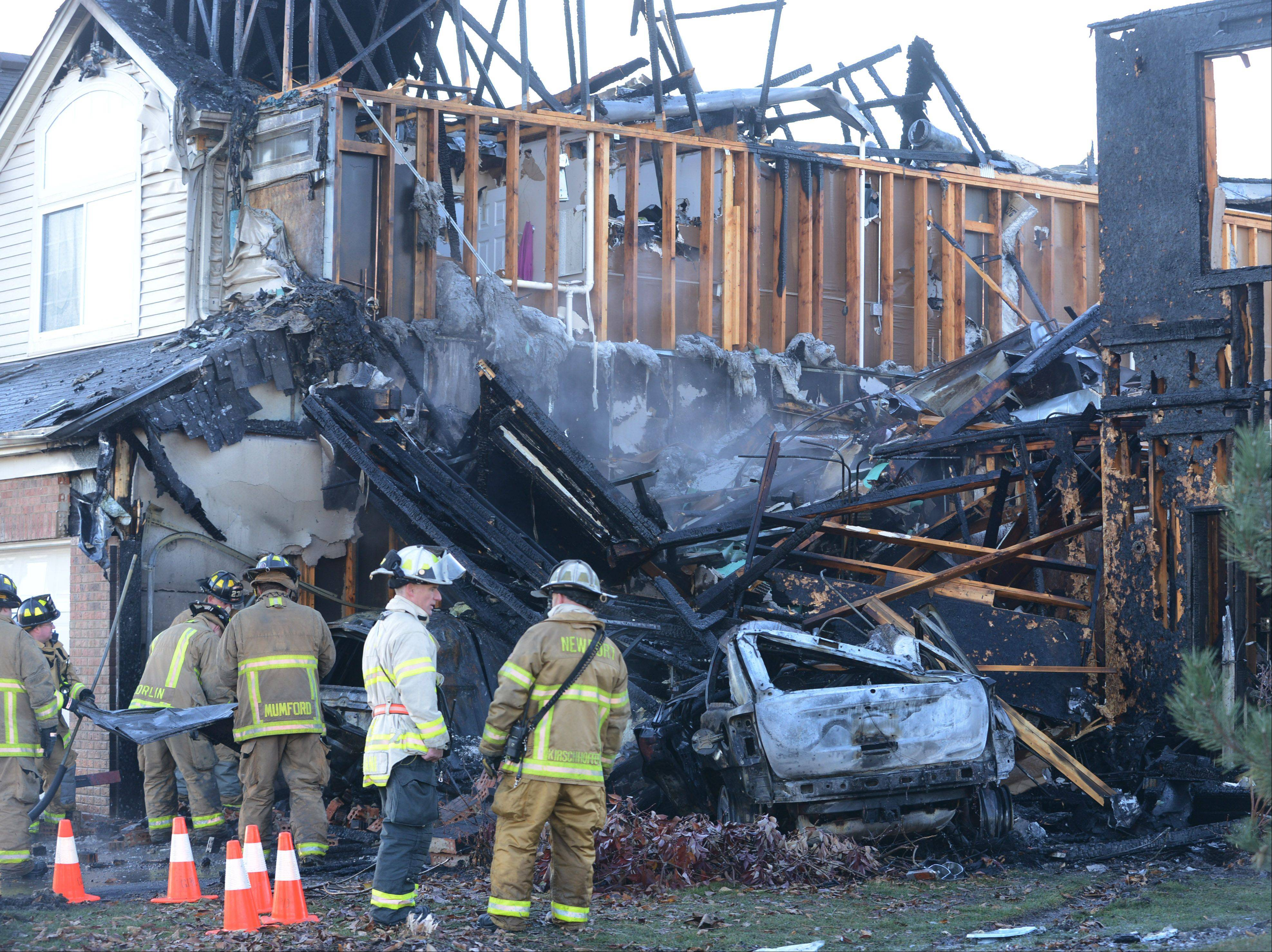 A townhouse was gutted by fire after a vehicle crashed into it early Friday morning on Patriot Drive in Hainesville.