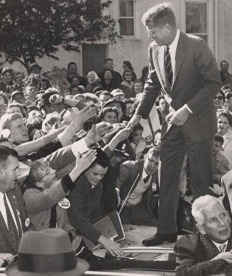 Sen. John F. Kennedy stood atop a car during this late October scene in Libertyville as he was greeted by people at a rally at Cook Park.