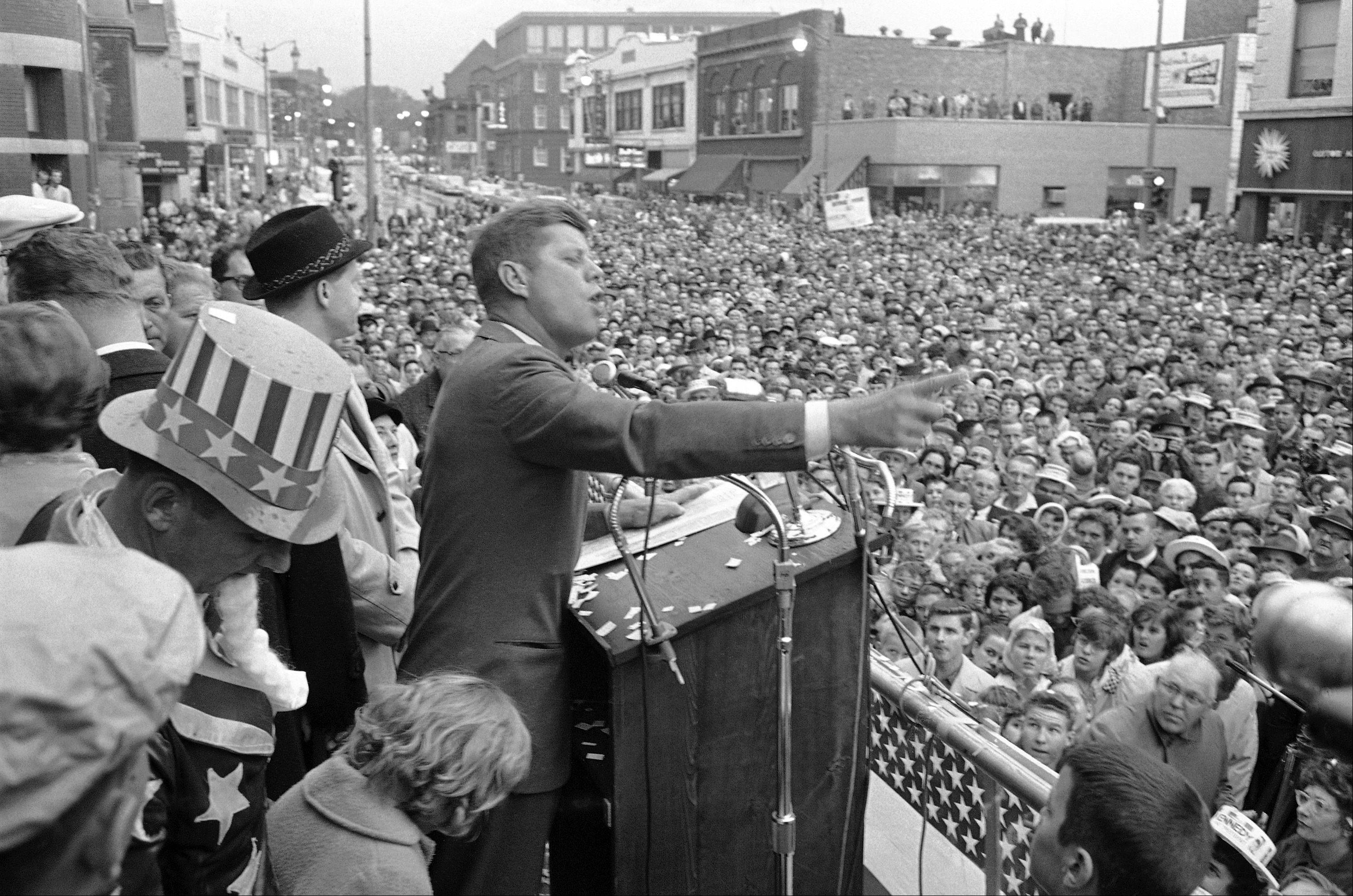 Sen. John F. Kennedy addresses a crowd of more than 10,000 packed in front of Aurora city hall on Oct. 25, 1960, as he toured numerous Chicago suburbs. Many people watched from rooftops, and Mayor Paul Egan said the crowd was the greatest assemblage in the history of Aurora.