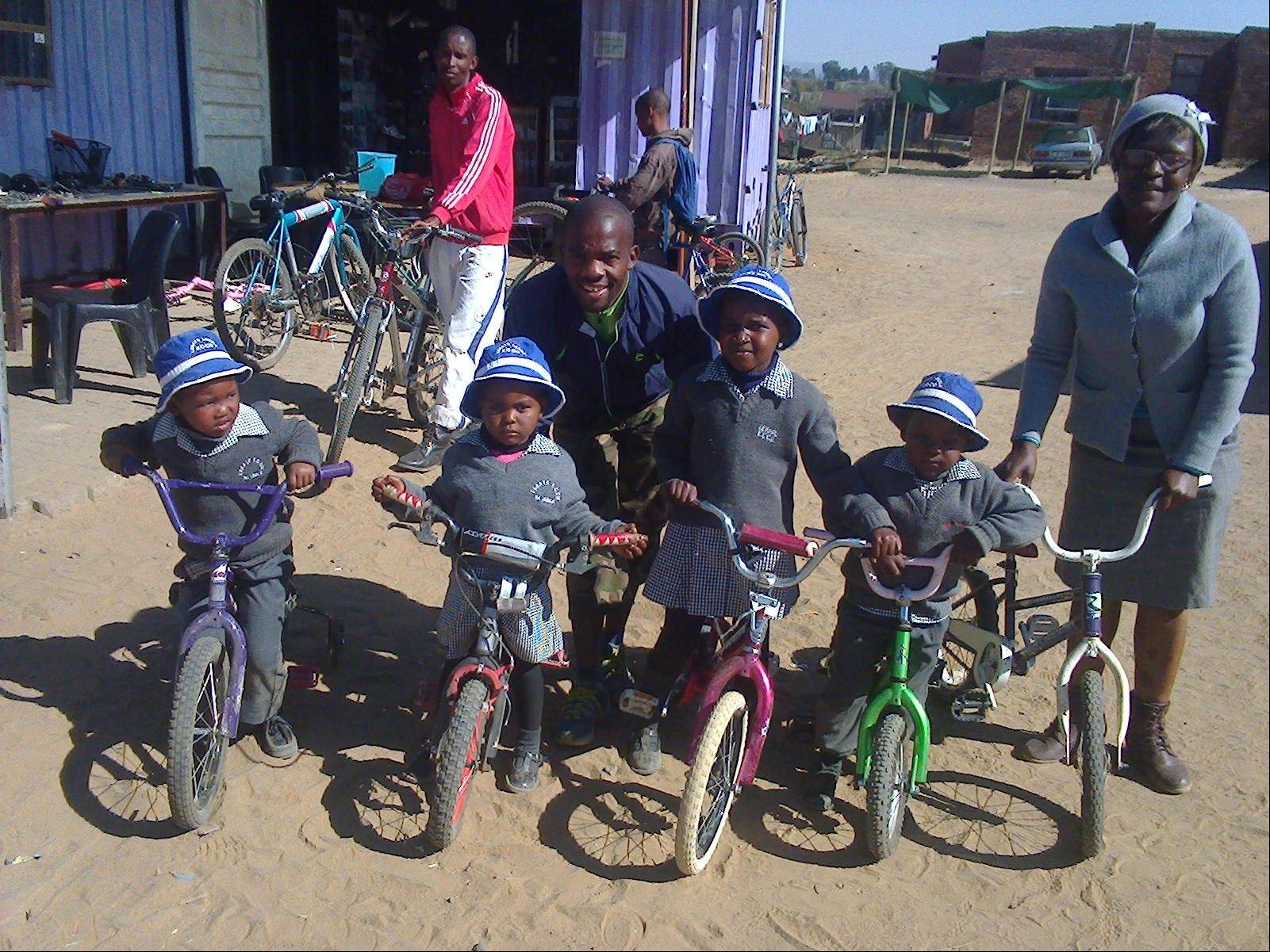 These four little boys from an orphanage in Lesotho received bikes from the shipment sent in May.