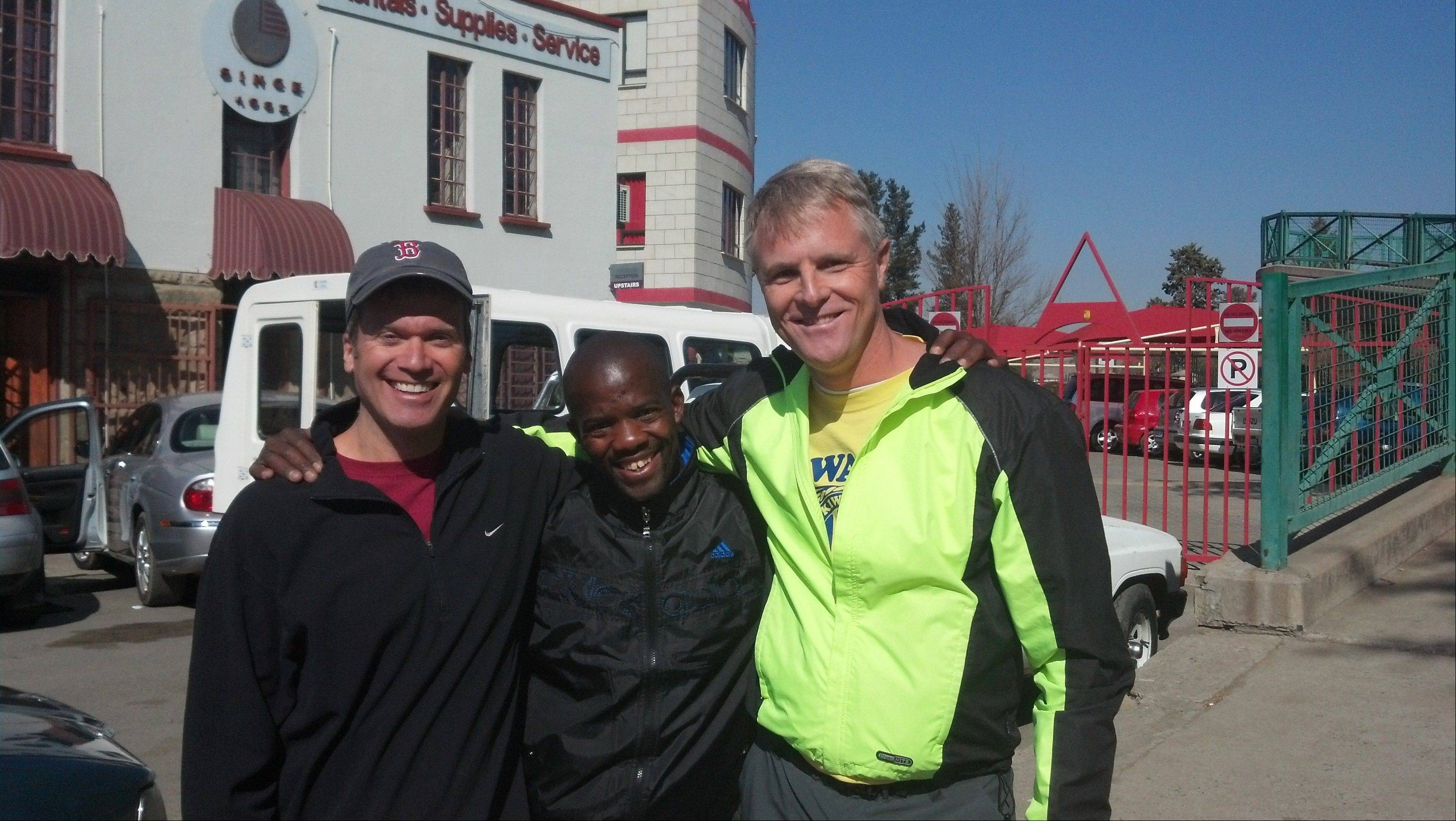 Jeff Teppema, left, and Dave Gorman, right, met Tumisang Taabe, head of the Lesotho Cycling Association, during their bike ride across the African country.