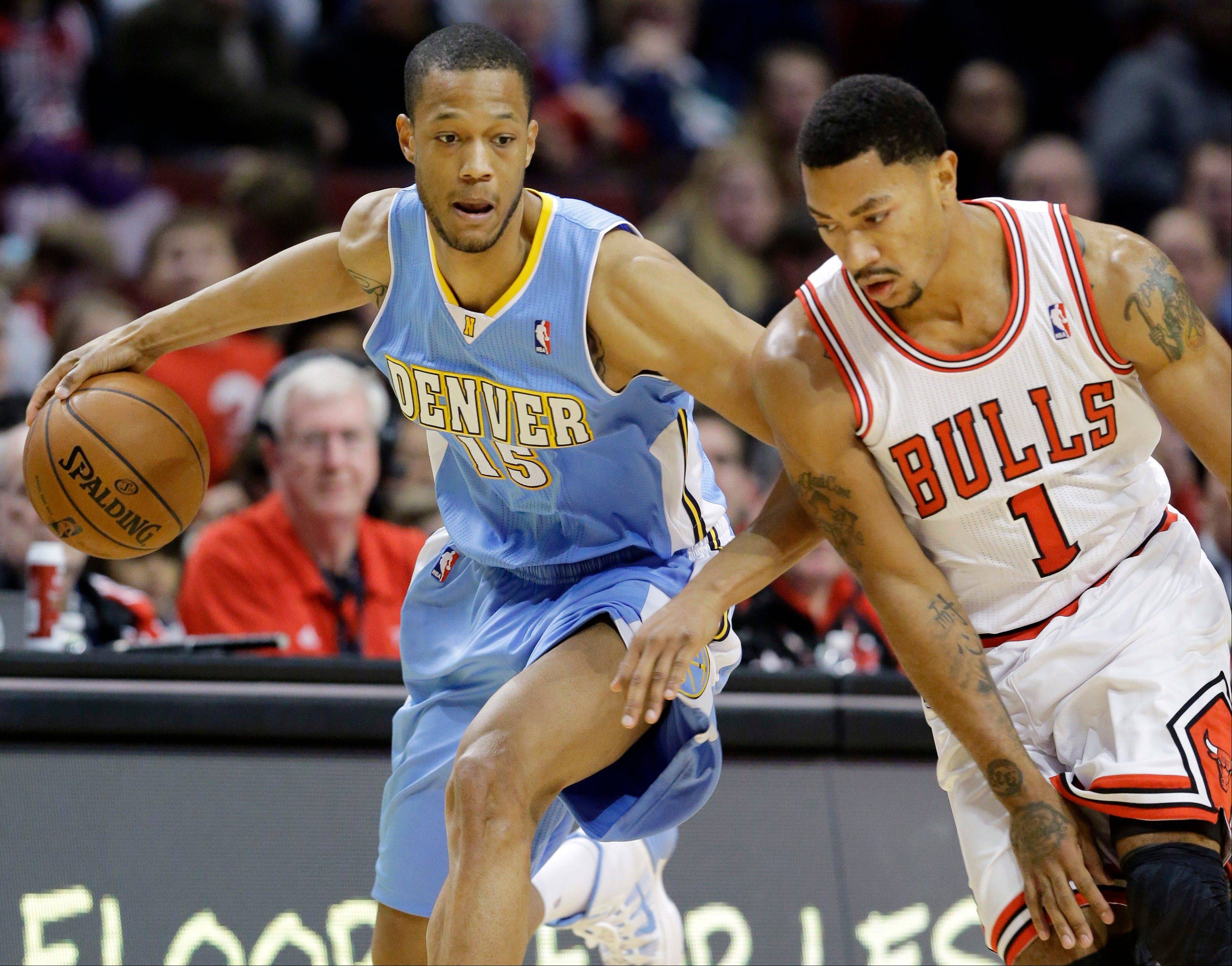Denver Nuggets forward Anthony Randolph (15) steals the ball from Chicago Bulls guard Derrick Rose during the first half of an NBA preseason basketball game in Chicago on Friday, Oct. 25, 2013.