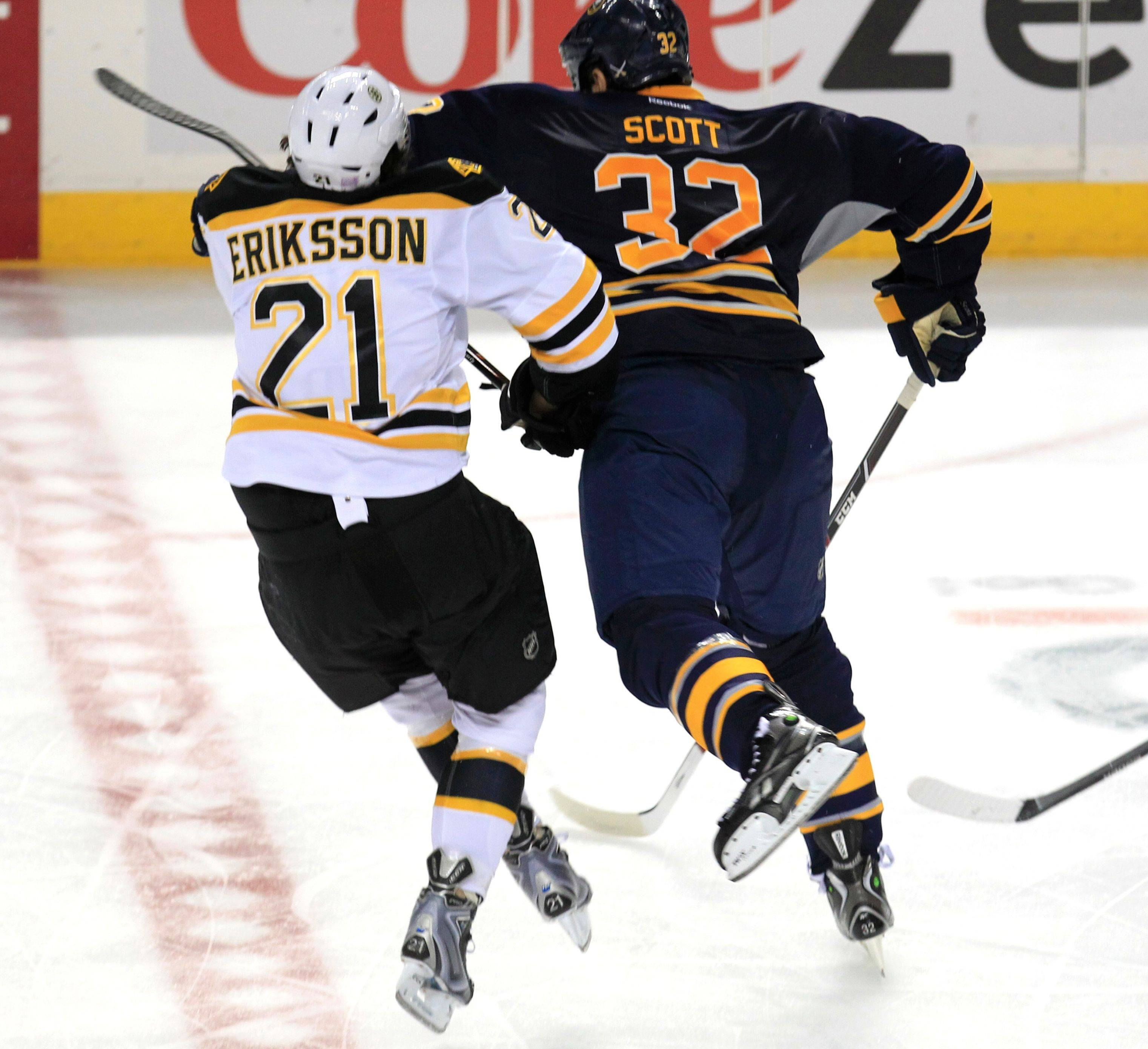 "Buffalo's John Scott checks Boston's Loui Eriksson during their game Wednesday. Scott, a former Blackhawk, was suspended and said he felt ""really upset"" after seeing the play on video. ""I was sick to my stomach,"" Scott added."
