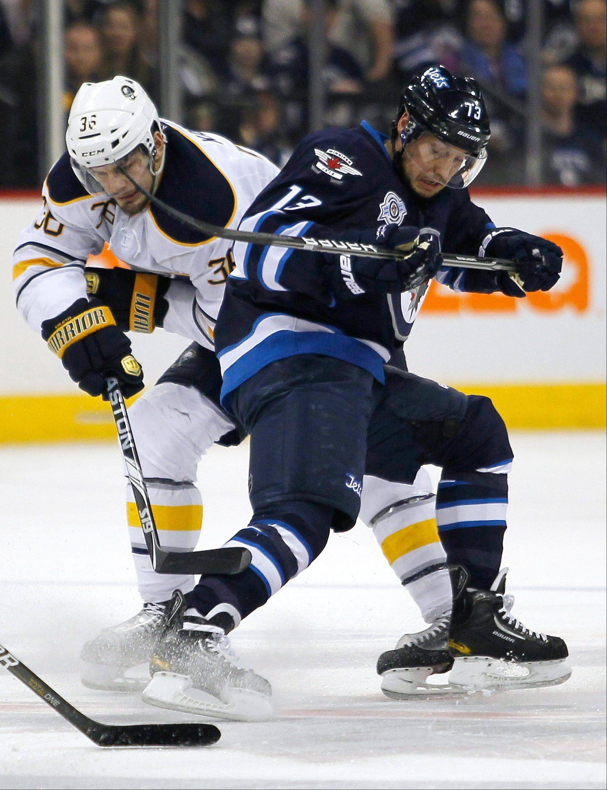 Kyle Wellwood and Buffalo's Patrick Kaleta (36) fight for the puck during second-period action two seasons ago. Kaleta is one of the dirtiest players in the NHL and Commissioner Gary Bettman refused to lower a 10-game suspension on Thursday.