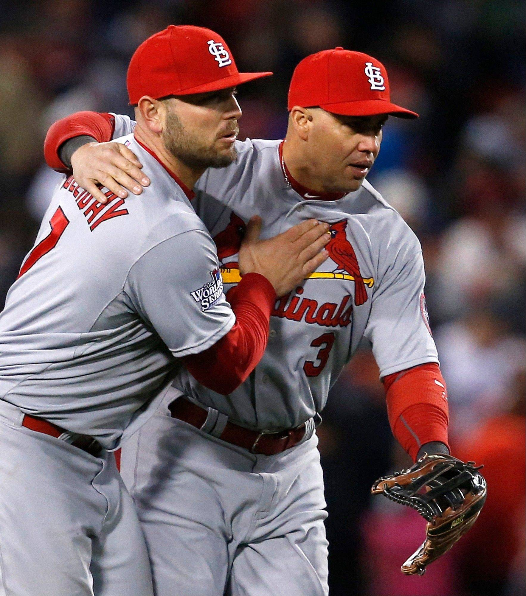 The Cardinals' Matt Holliday, left, and Carlos Beltran celebrate after Game 2 of the World Series against the Boston Red Sox on Thursday at Fenway Park. The Cardinals won 4-2 to tie the series at 1-1.
