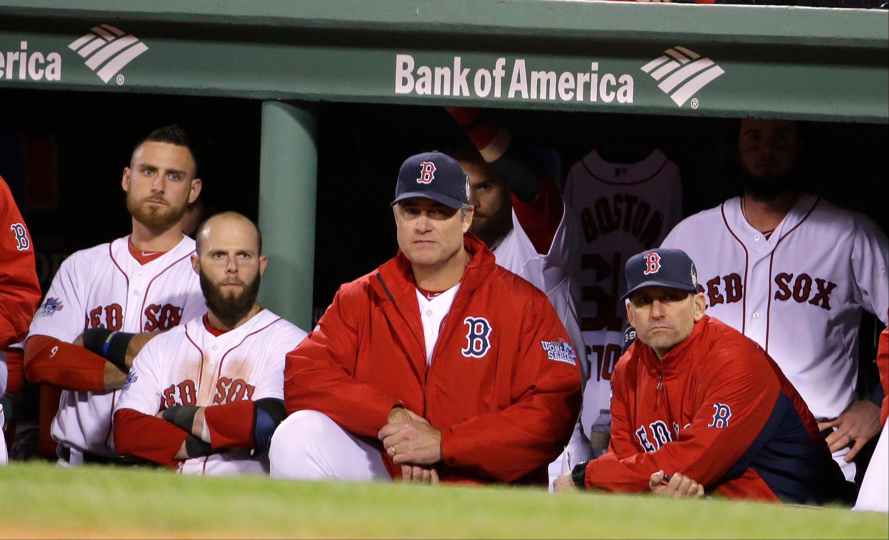 Boston Red Sox manager John Farrell and players watch during the ninth inning of Game 2.