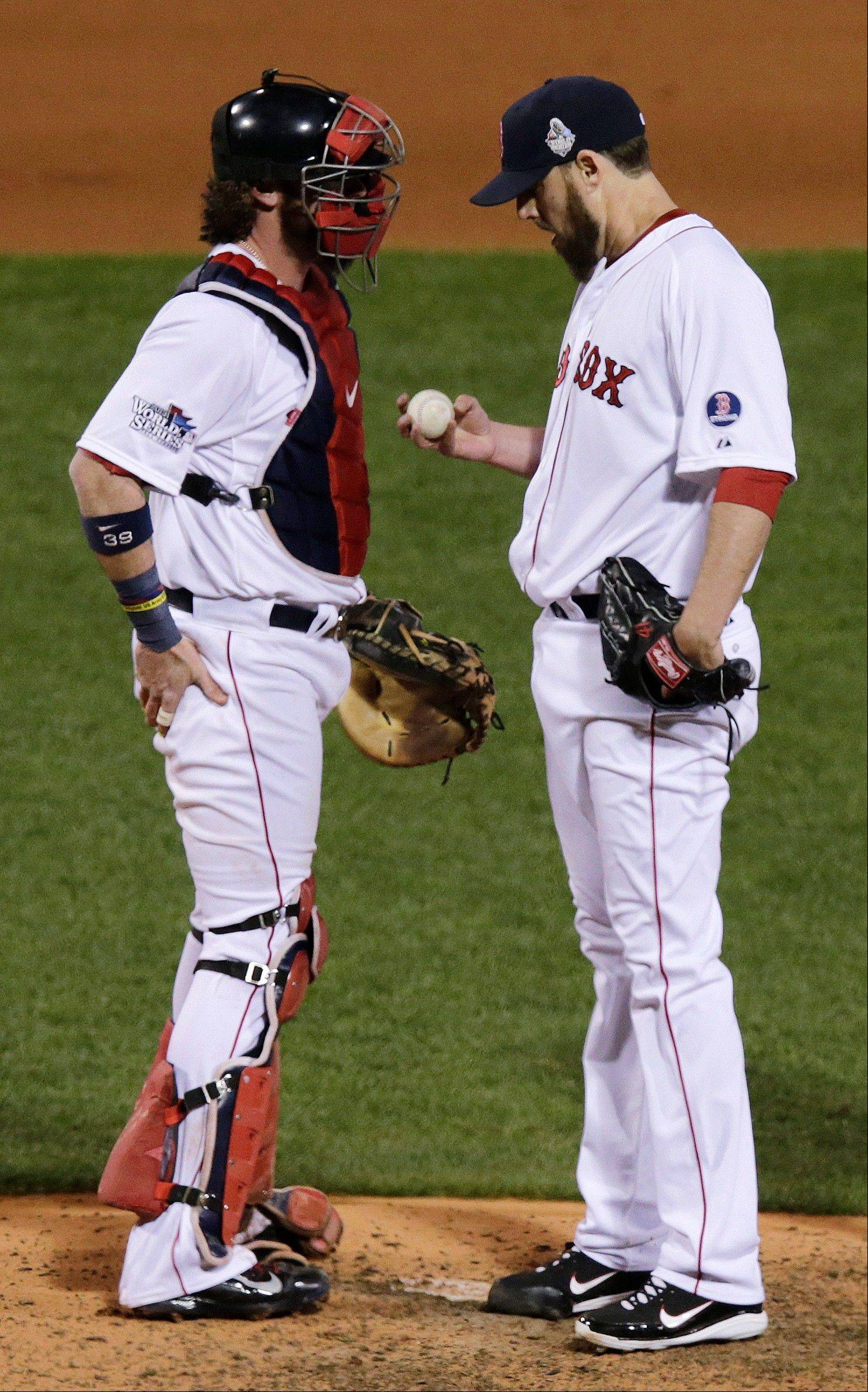 Boston Red Sox starting pitcher John Lackey, right, confers with catcher Jarrod Saltalamacchia before being taken out of the game during the seventh inning.