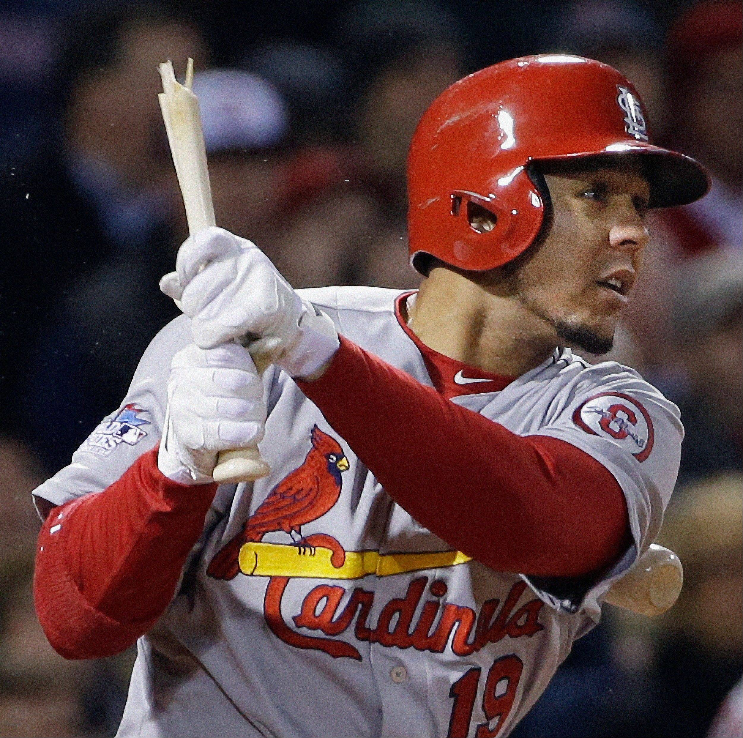 The Cardinals' Jon Jay breaks his bat as he flies out during the fifth inning.