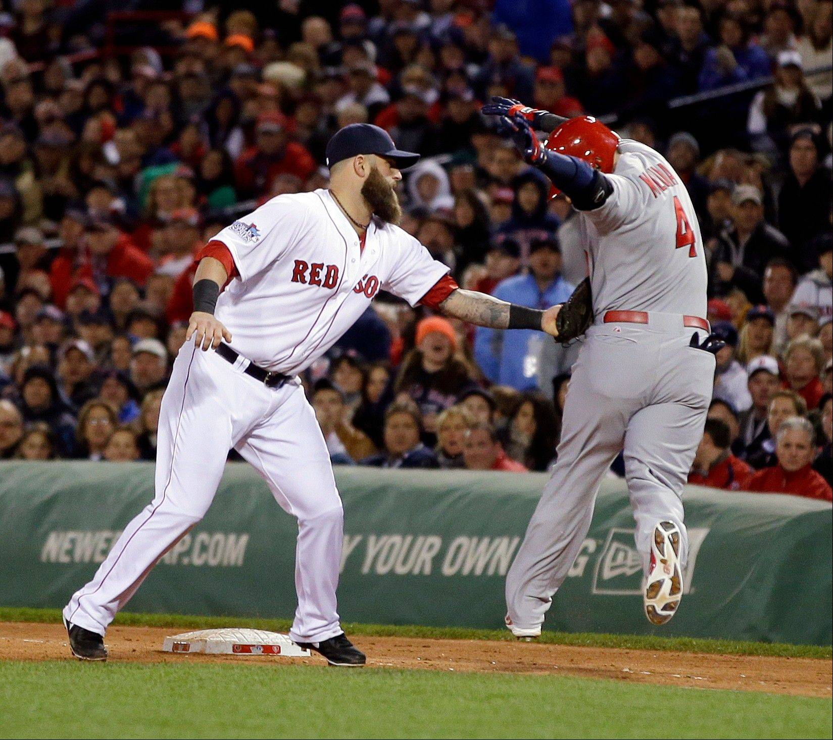 Boston's Mike Napoli tags out the Cardinals' Yadier Molina during the fourth inning.