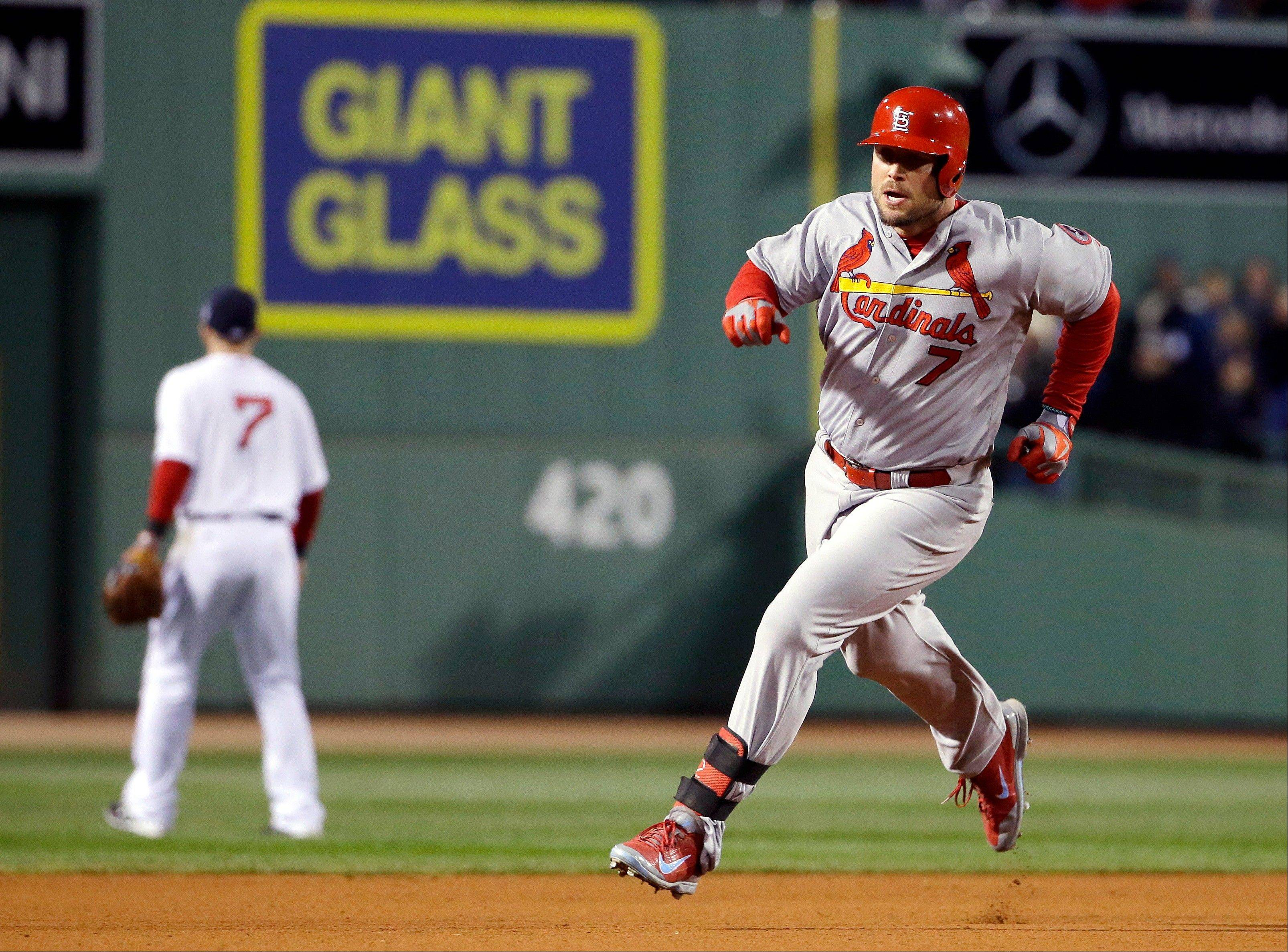 The Cardinals' Matt Holliday runs the bases on his fourth-inning triple.