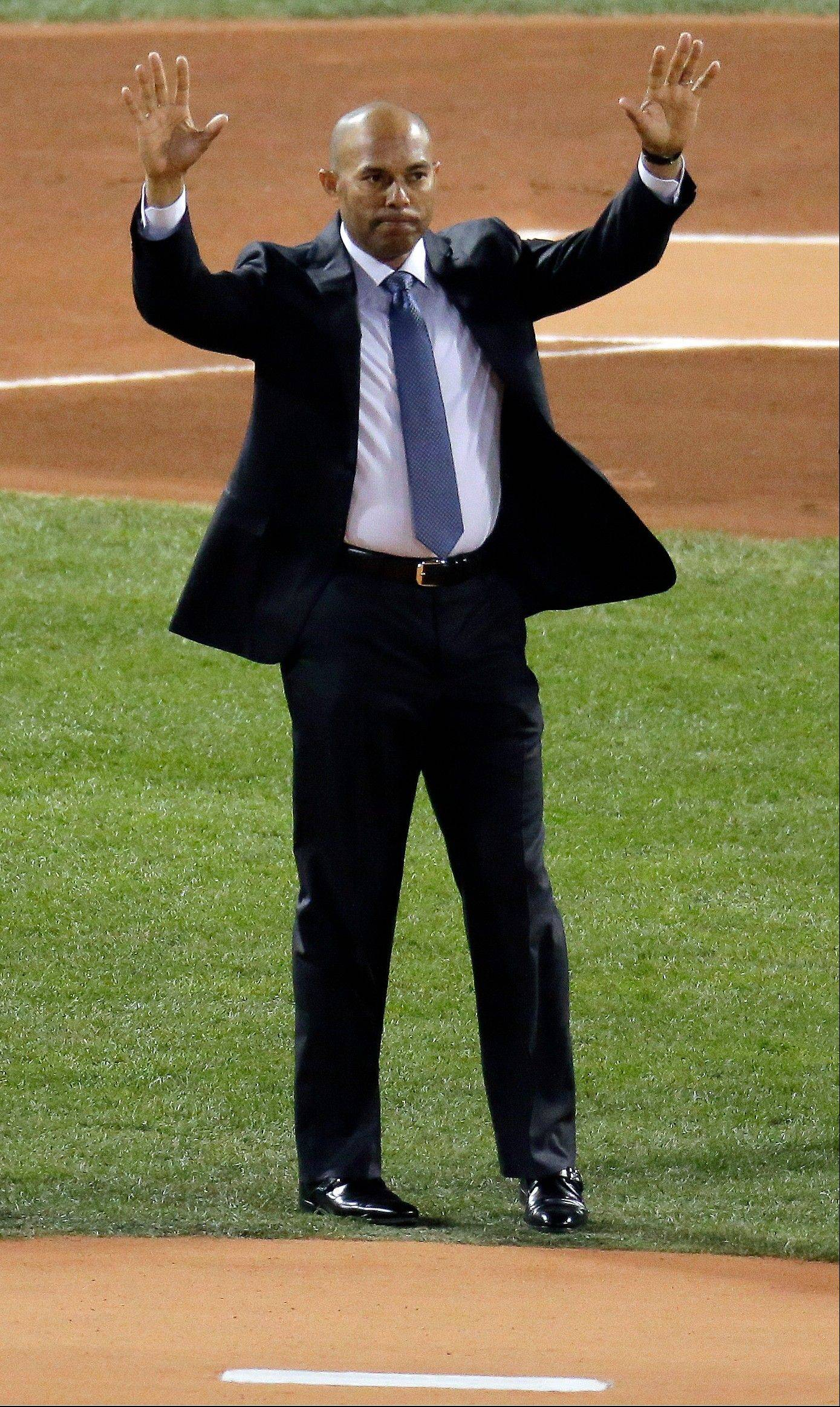 Former New York Yankees pitcher Mariano Rivera acknowledges the crowd before Game 2 of the World Series in Boston.