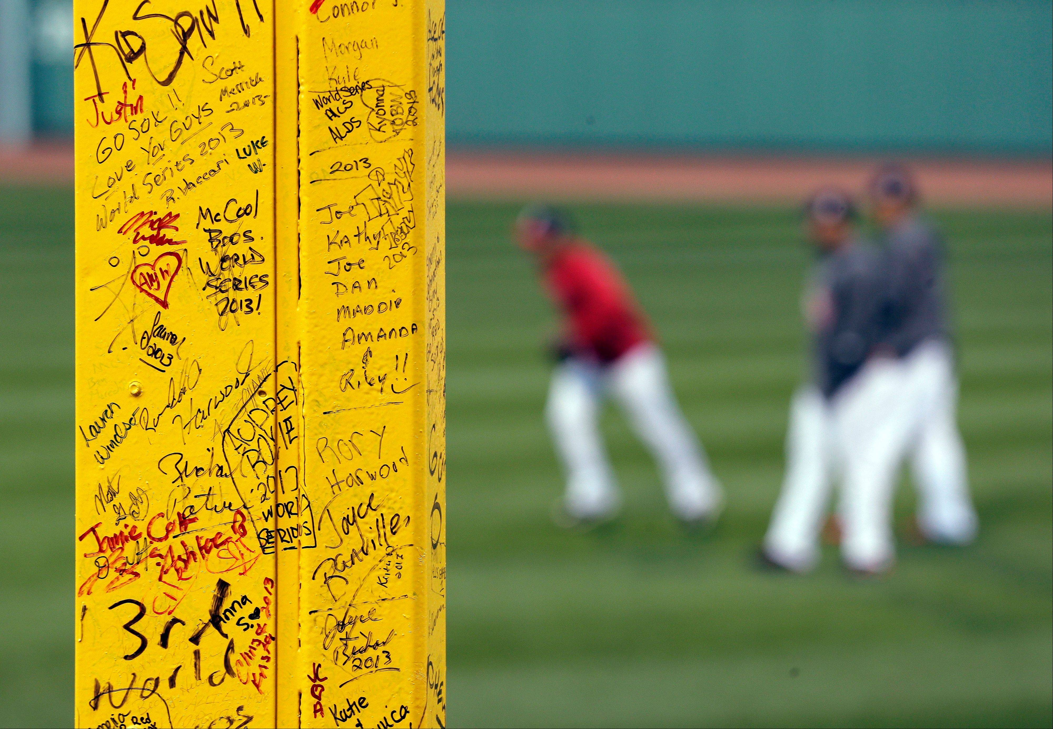 "Fans' signatures adorn ""Pesky's Pole"" in right field at Fenway Park."