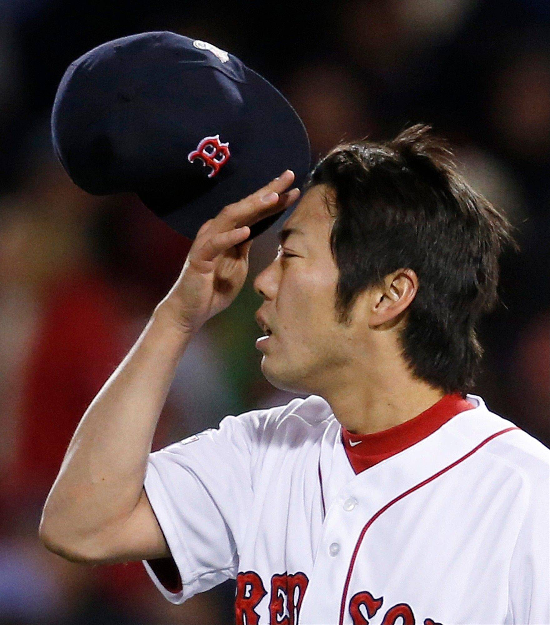 Boston Red Sox relief pitcher Koji Uehara rubs his forehead during the ninth inning of Game 2.