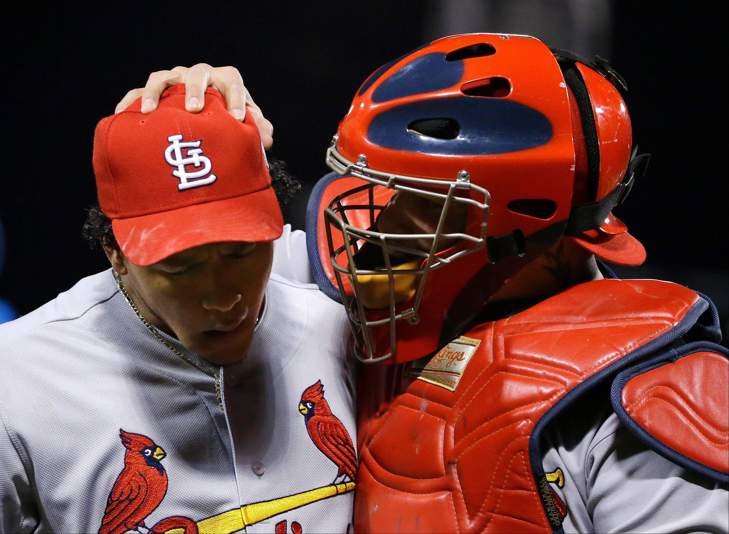 St. Louis Cardinals relief pitcher Carlos Martinez, left, gets some encouragement from catcher Yadier Molina during the eighth inning of Game 2.
