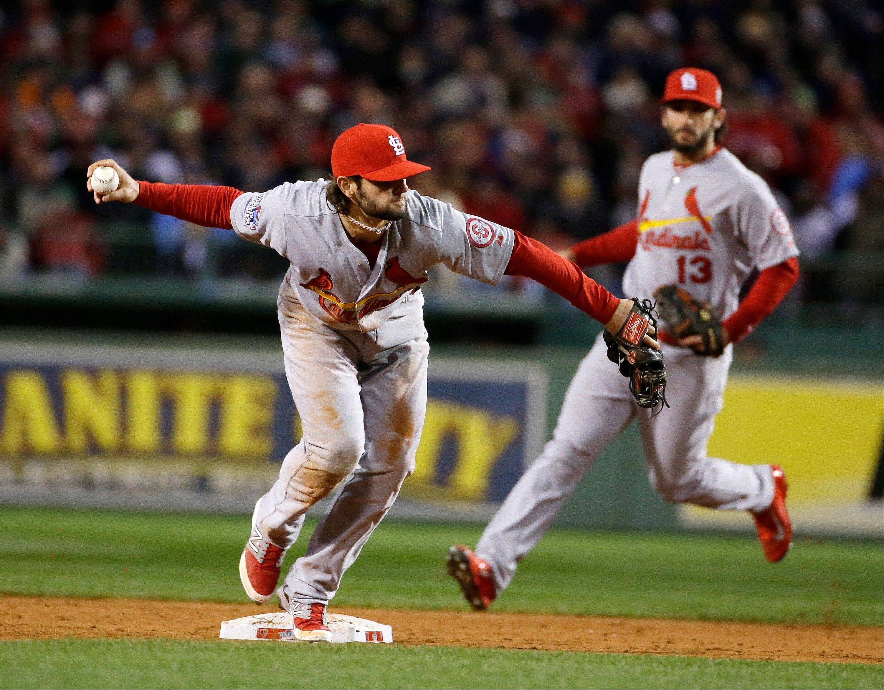 The Cardinals' Pete Kozma throws out Boston's Stephen Drew at first during the seventh inning of Game 2.
