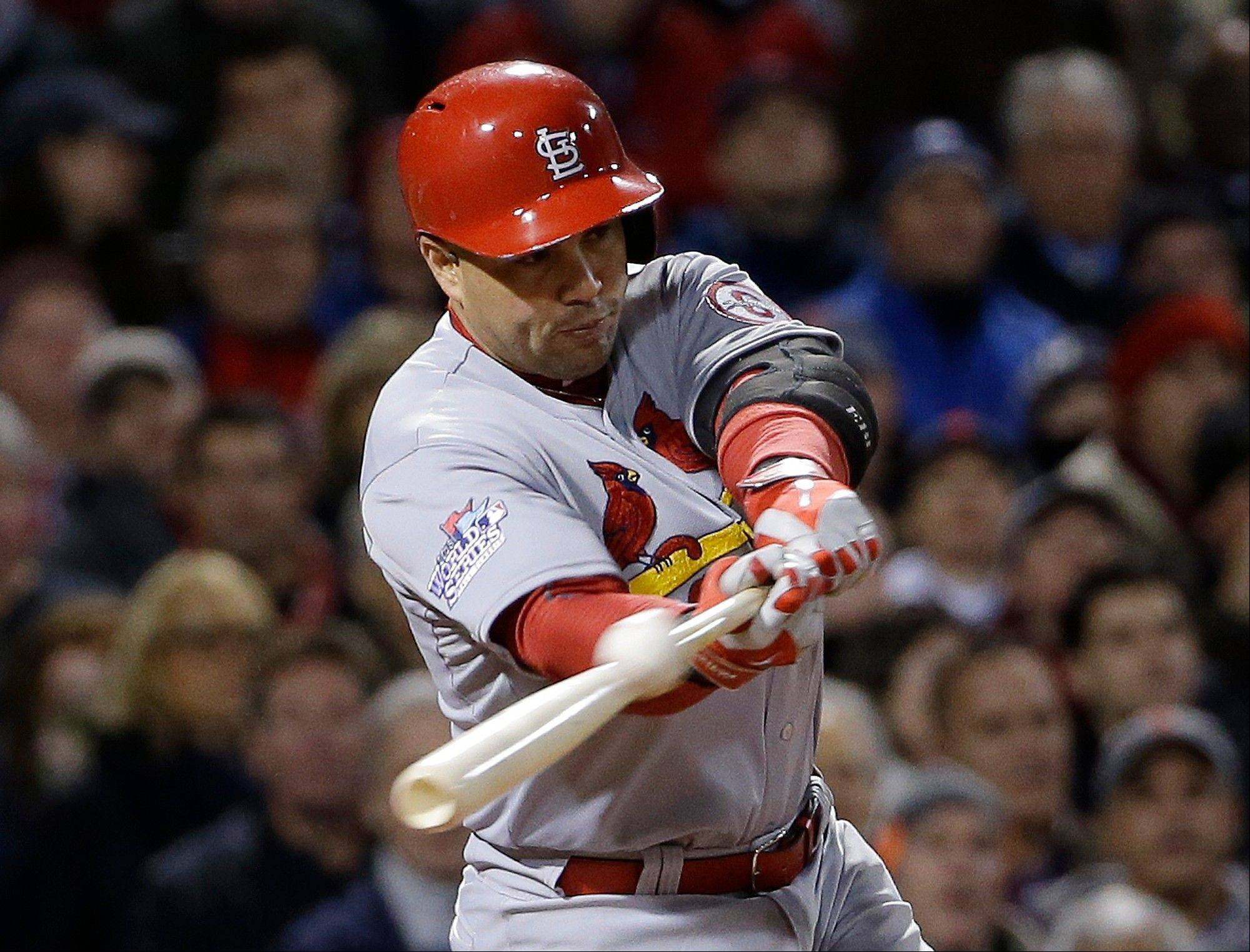 Carlos Beltran hits an RBI single for St. Louis during the seventh inning of Game 2.