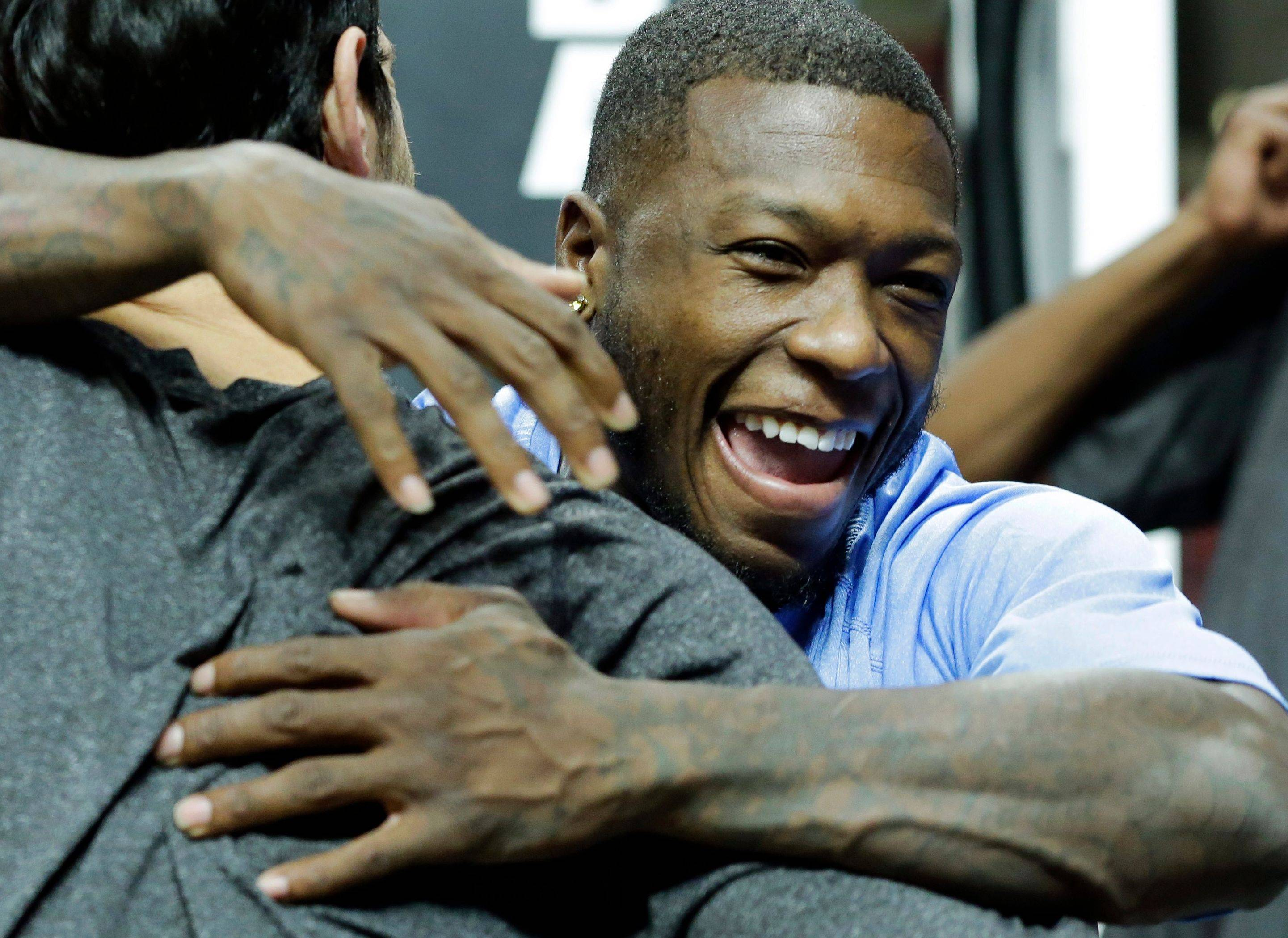 "Nuggets guard Nate Robinson, right, hugs former teammate and Bulls guard Kirk Hinrich before Friday's game. ""It was a very special season,"" Robinson said of his time in Chicago. ""I miss it. I'd be lying if I said I didn't."""