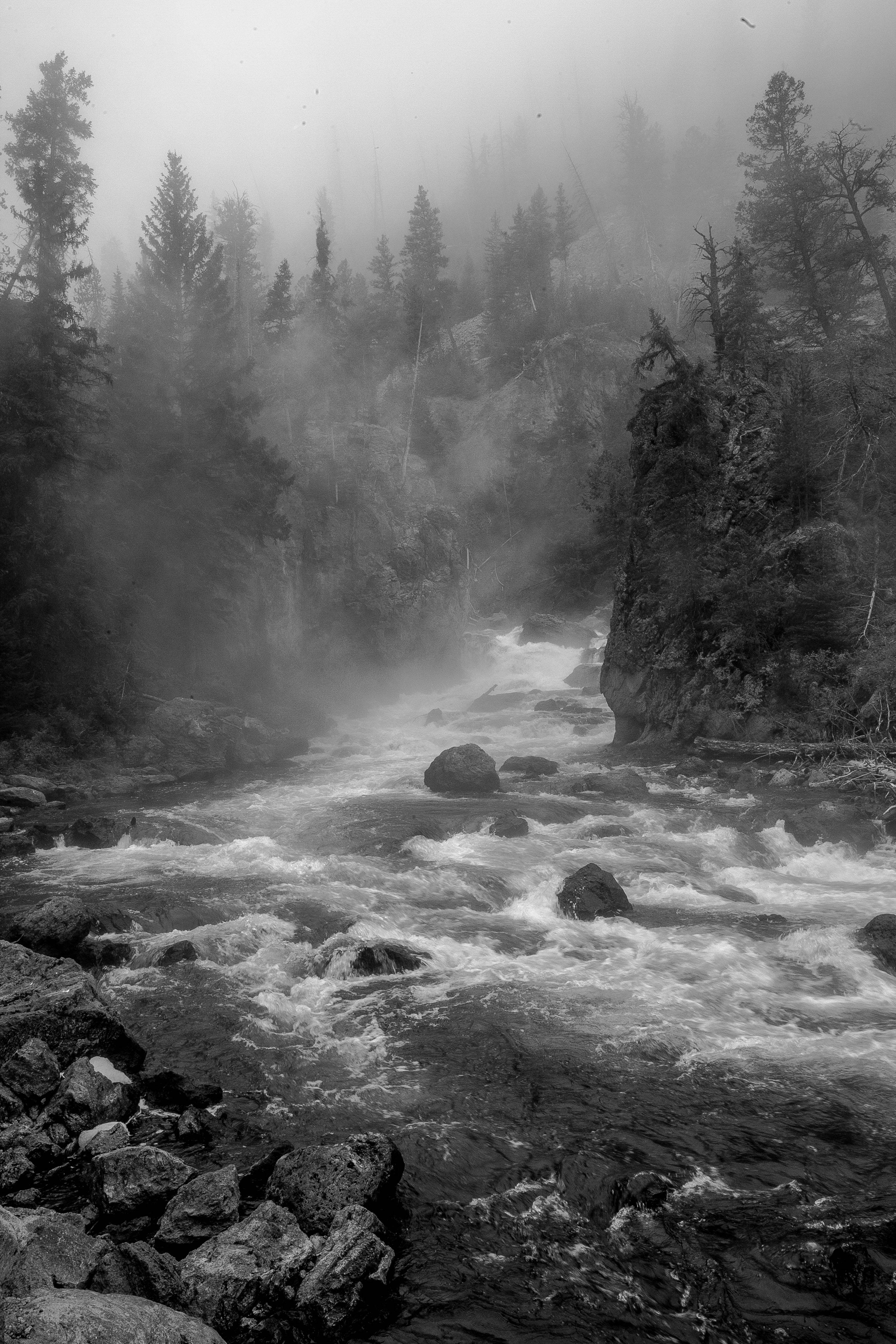 """Misty Morning"" by Mike Smith is a black and white photograph of one of the many waterfalls in Yellowstone National Park and will be on display throughout the month of November 2013 at Gallery 200 in West Chicago as part of his exhibit ""Our National Parks."""