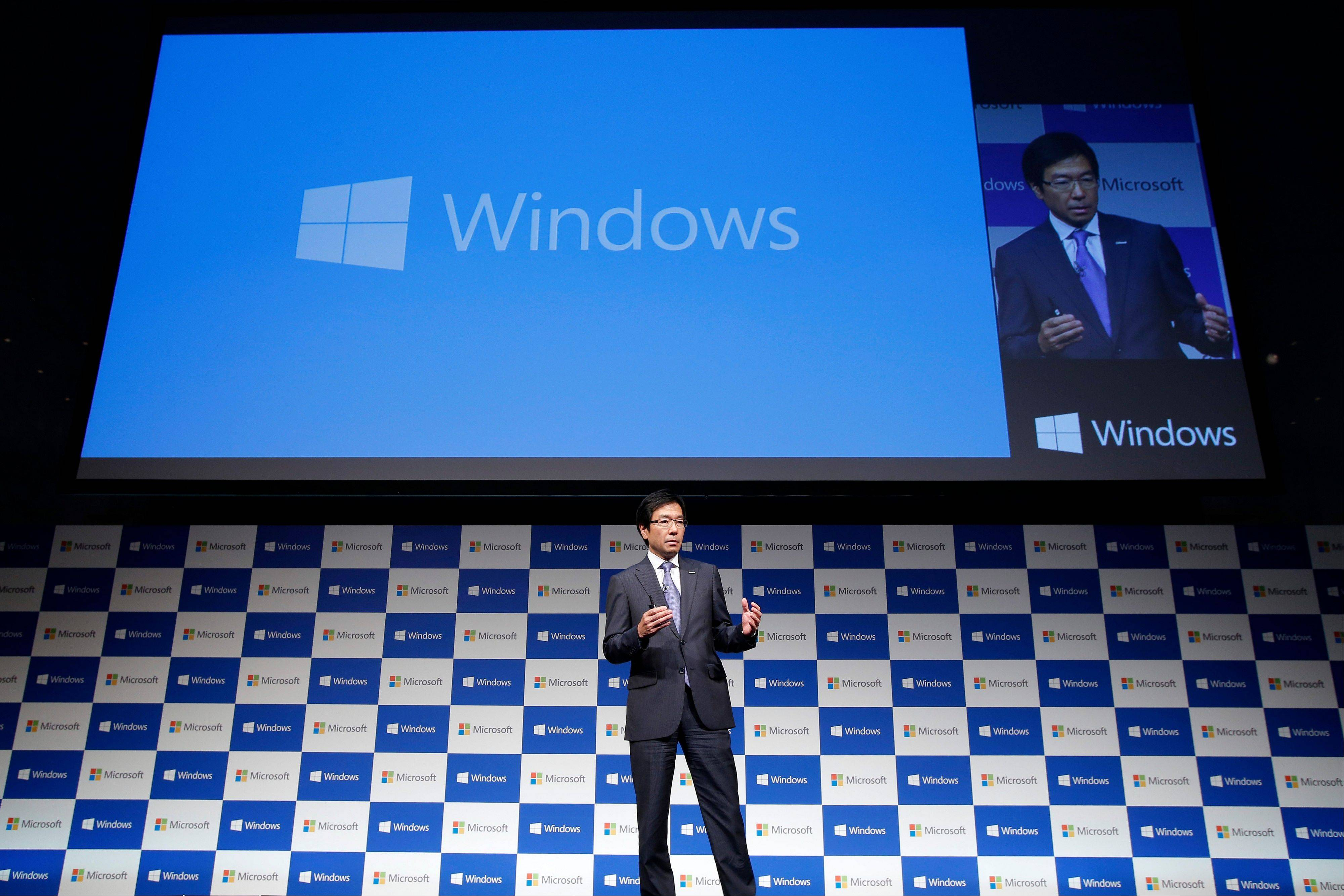 Yasuyuki Higuchi, president and chief executive officer of Microsoft Japan Co., speaks during a launch event for Microsoft Corp.�s Windows 8.1 operating system in Tokyo.