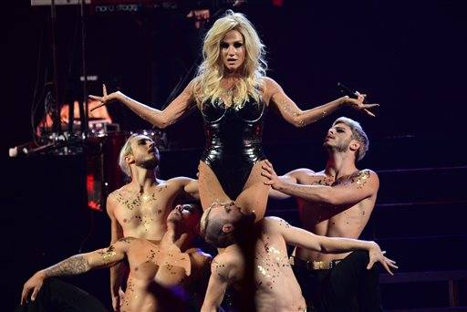 In this September photo, Ke$ha performs at the IHeartRadio Music Festival, in Las Vegas. Authorities in Muslim-majority Malaysia have banned a planned concert by U.S. pop singer Ke$ha after deciding it would hurt cultural and religious sensitivities.