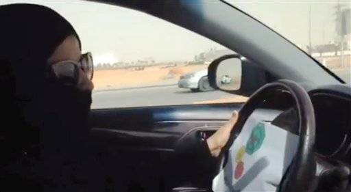 In this image made from video provided by theOct26thDriving campaign, which has been authenticated based on its contents and other AP reporting, a Saudi woman drives a vehicle in Riyadh, Saudi Arabia, Saturday, Oct. 26, 2013. A Saudi woman said she got behind the wheel Saturday and drove to the grocery store without being stopped or harassed by police, kicking off a campaign protesting the ban on women driving in the ultraconservative kingdom.