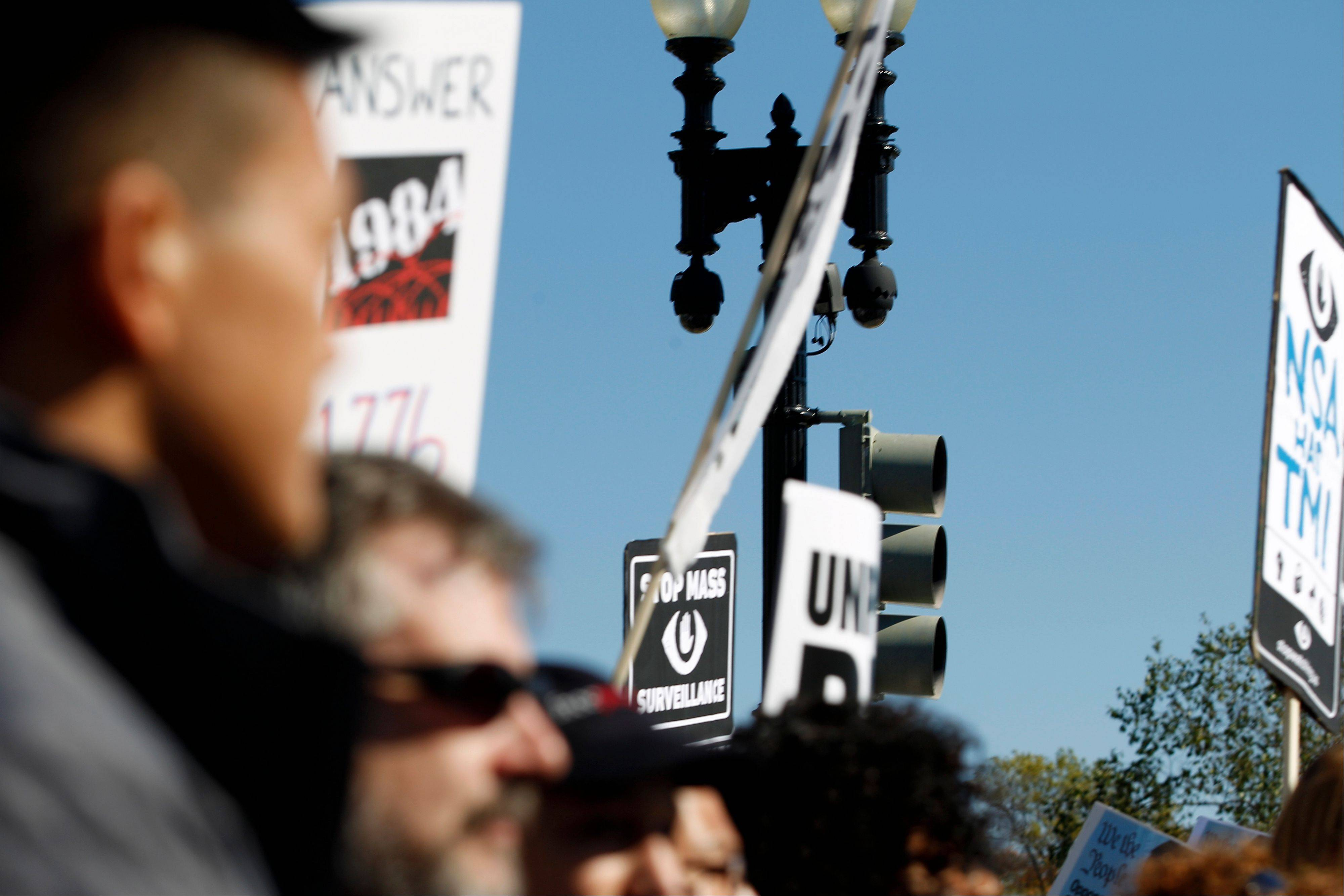 Surveillance cameras are visible Saturday near the U.S. Capitol in Washington during a rally to protest against the National Security Agency�s spying on Americans.