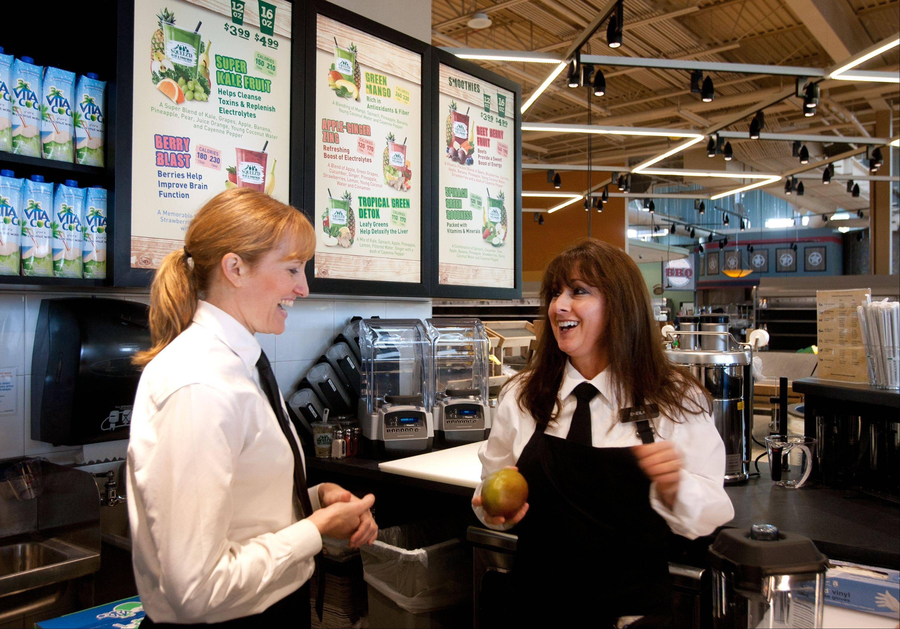 Amelia Hodak, left, and Sheila Buck, discuss smoothie recipes at the smoothie bar located just inside Mariano�s entrance.