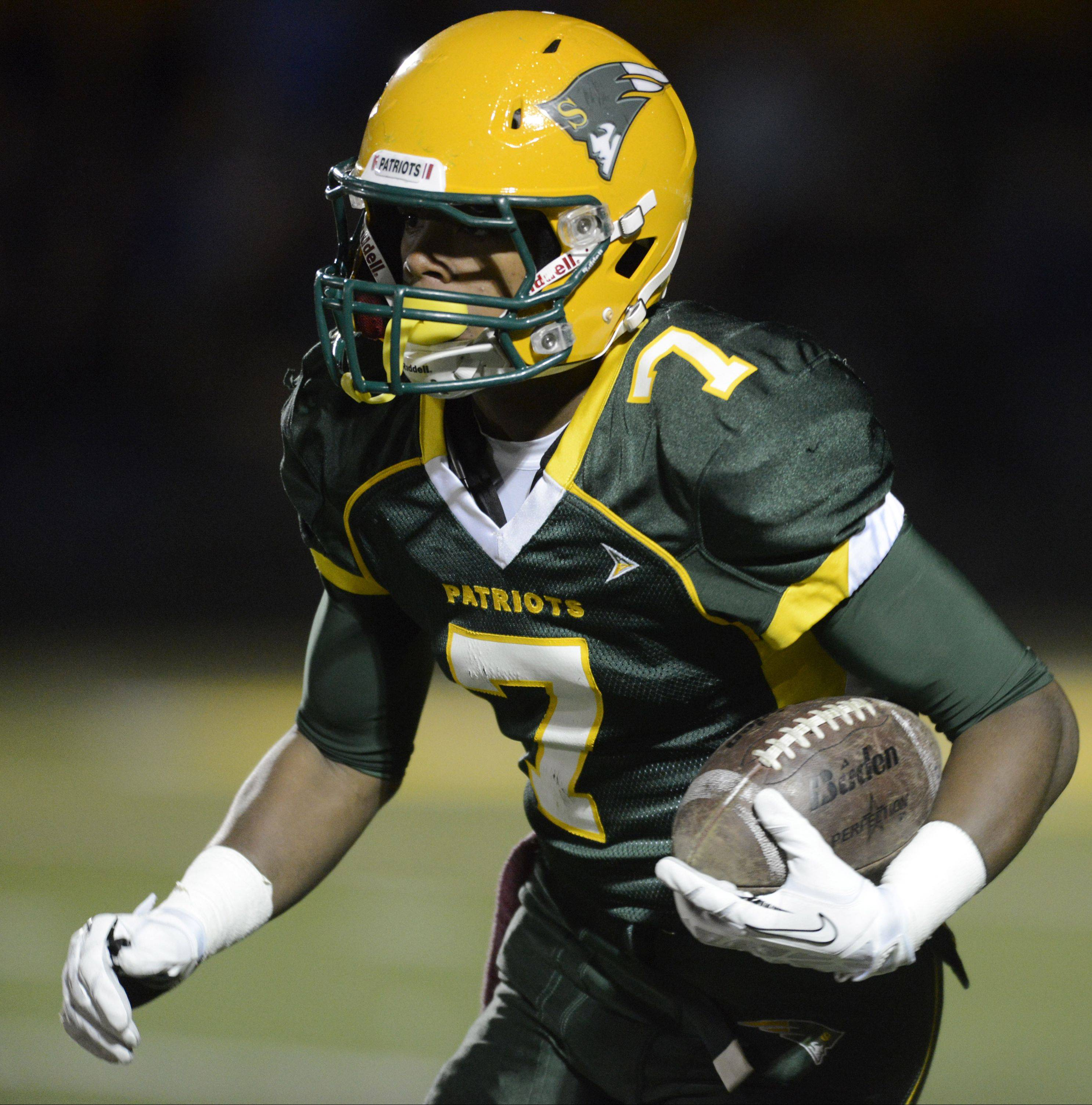 Stevenson�s Cameron Green carries the ball on a kickoff return during Friday�s game against Lake Zurich. The Patriots got a No. 6 seed in Class 8A and will host St. Charles East in the first round of the state playoffs next weekend.