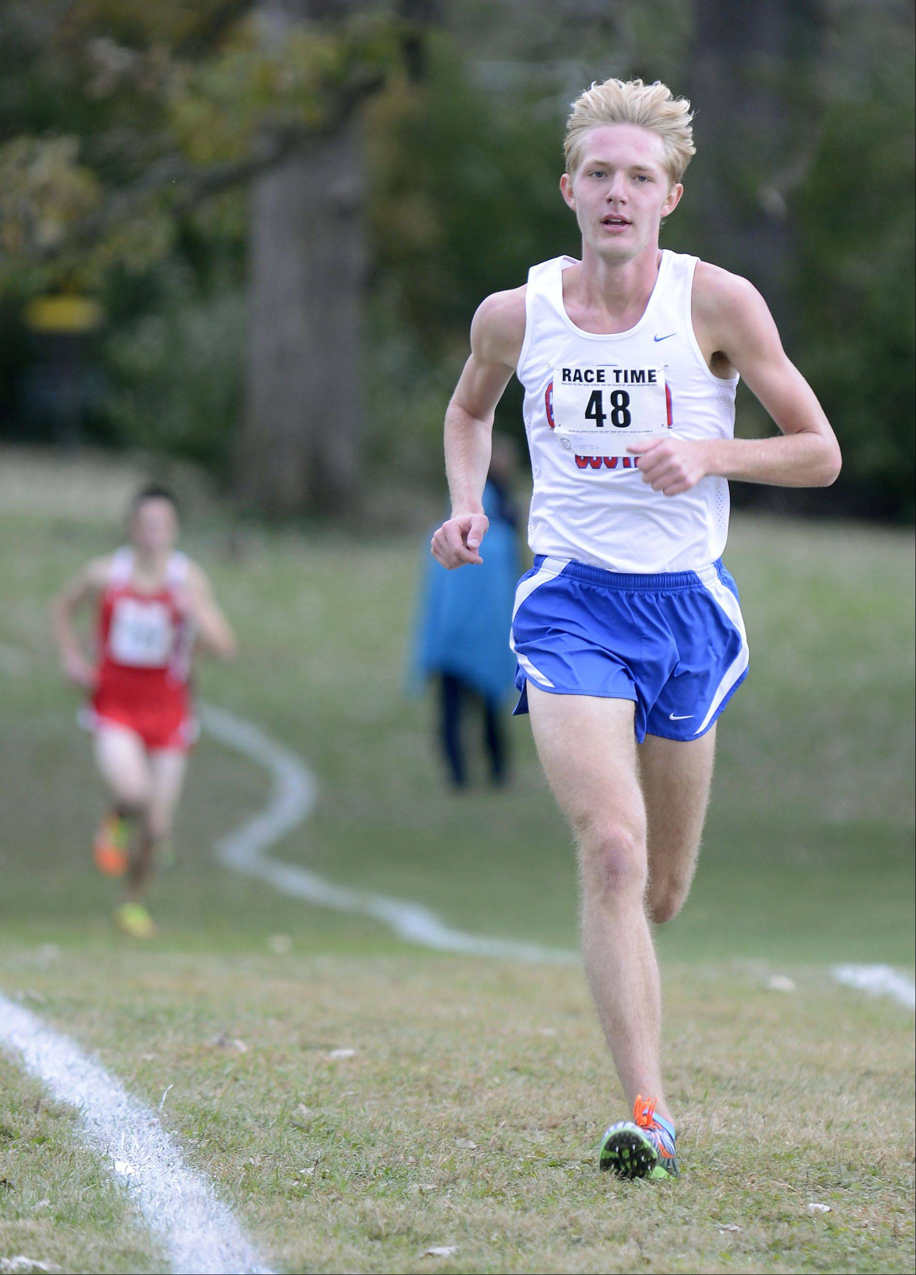 Glenbard South's John Wold takes first place in the Class 2A cross country regional on Saturday, October 26.