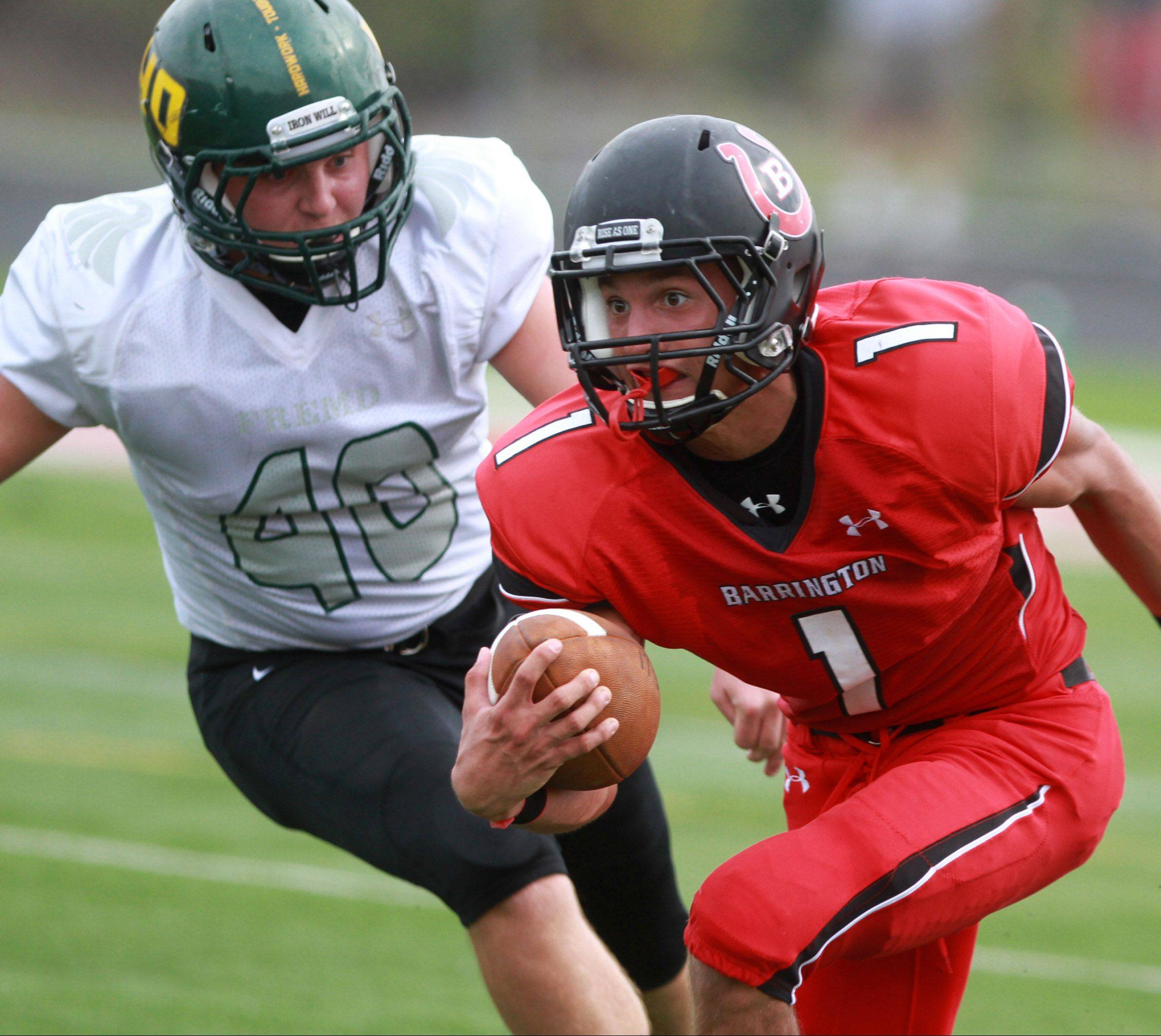 Barrington's Scotty Miller eludes Fremd defender Ryan Tarallo at Barrington in Week 6.