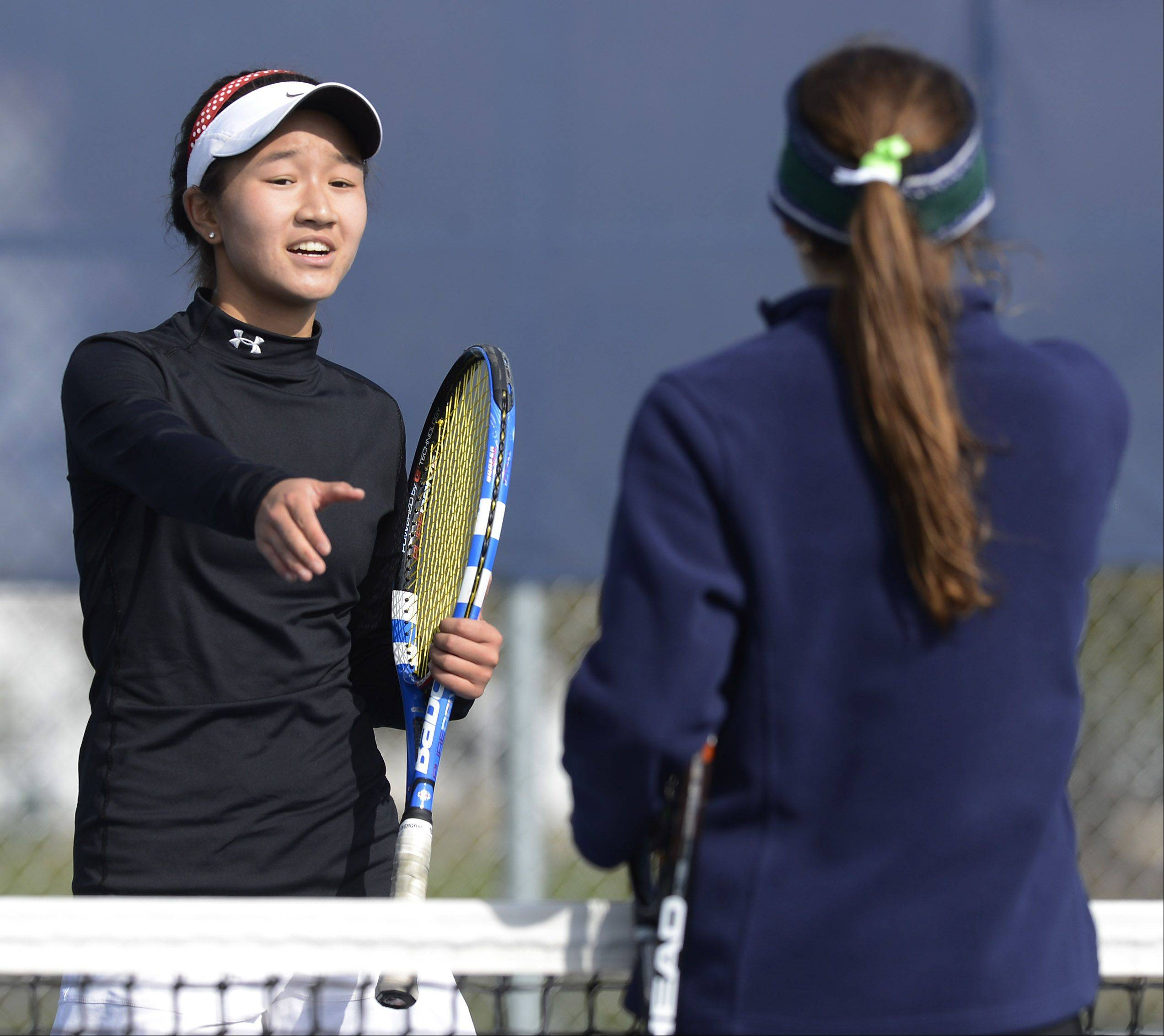 Naperville Central�s Tiffany Chen shakes hands with her opponent, Carol Finke of New Trier, after winning 6-2, 3-6, 7-5 during the girls state tennis semifinals at Buffalo Grove High School Saturday.