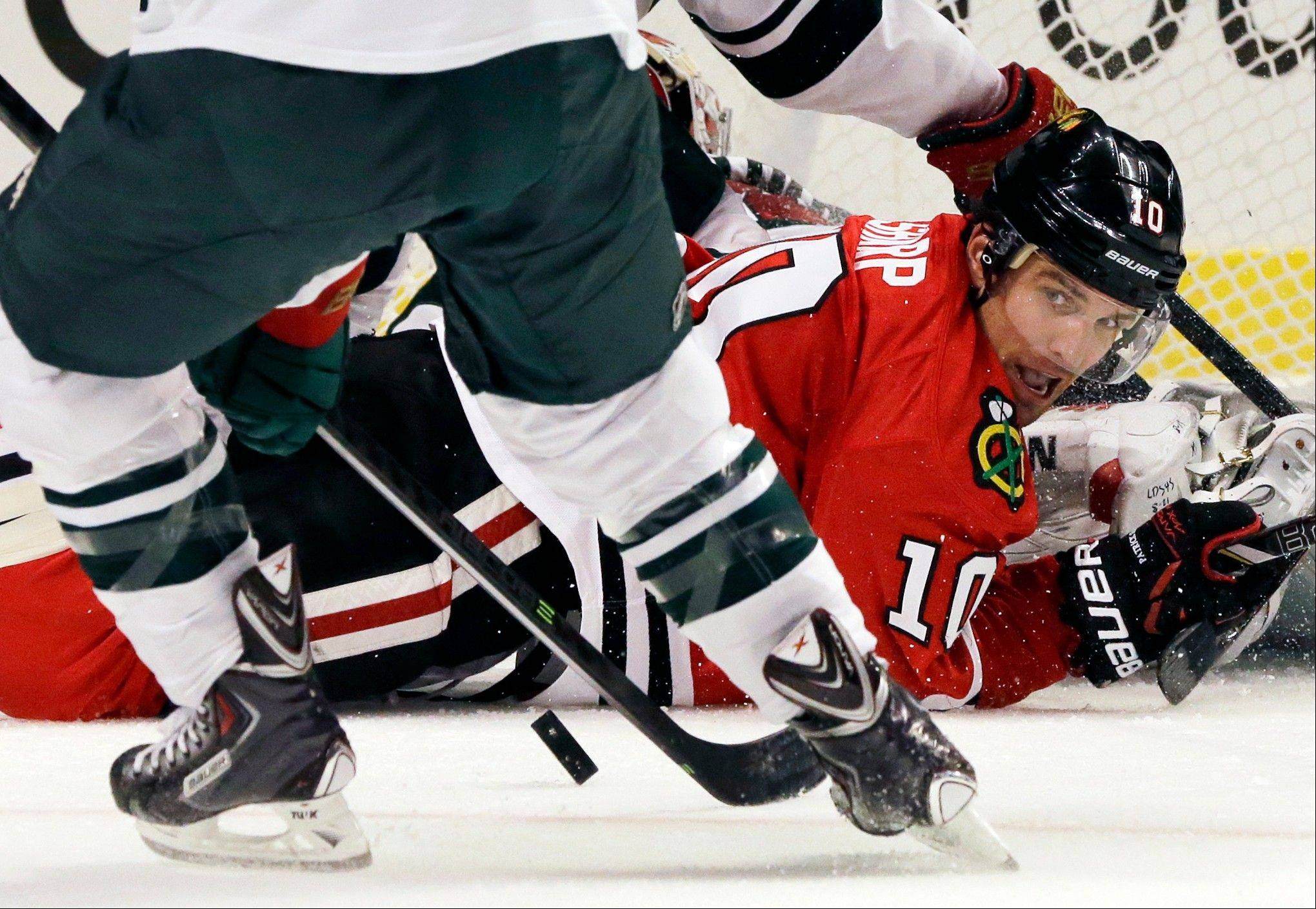 The Blackhawks' Patrick Sharp watches the puck after failing to score in the second period Saturday night.