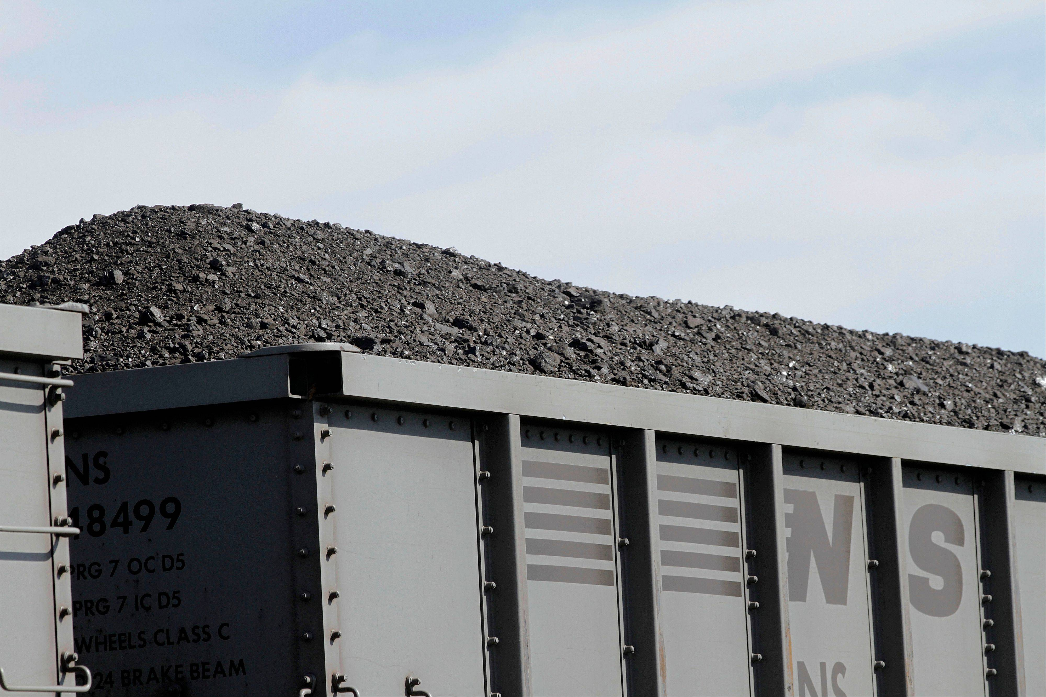 A Norfolk Southern Railroad train pulls transport cars full of coal near Goodfield, Ill. The United States cut its energy-related carbon dioxide pollution by 3.8 percent in 2012, the second biggest drop since 1990, the Department of Energy said Monday.