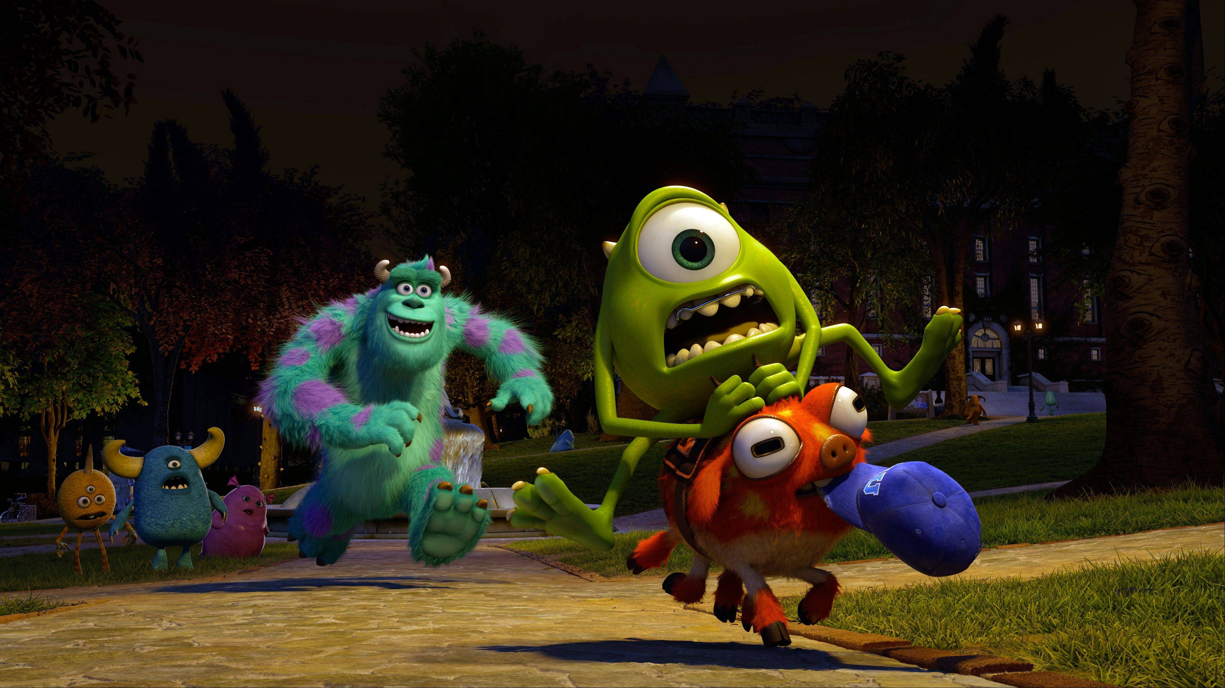 "In Pixar's ""Monsters University,"" Sully (John Goodman) chases after his fraternity brother Mike (Billy Crystal) during the Scare Games."