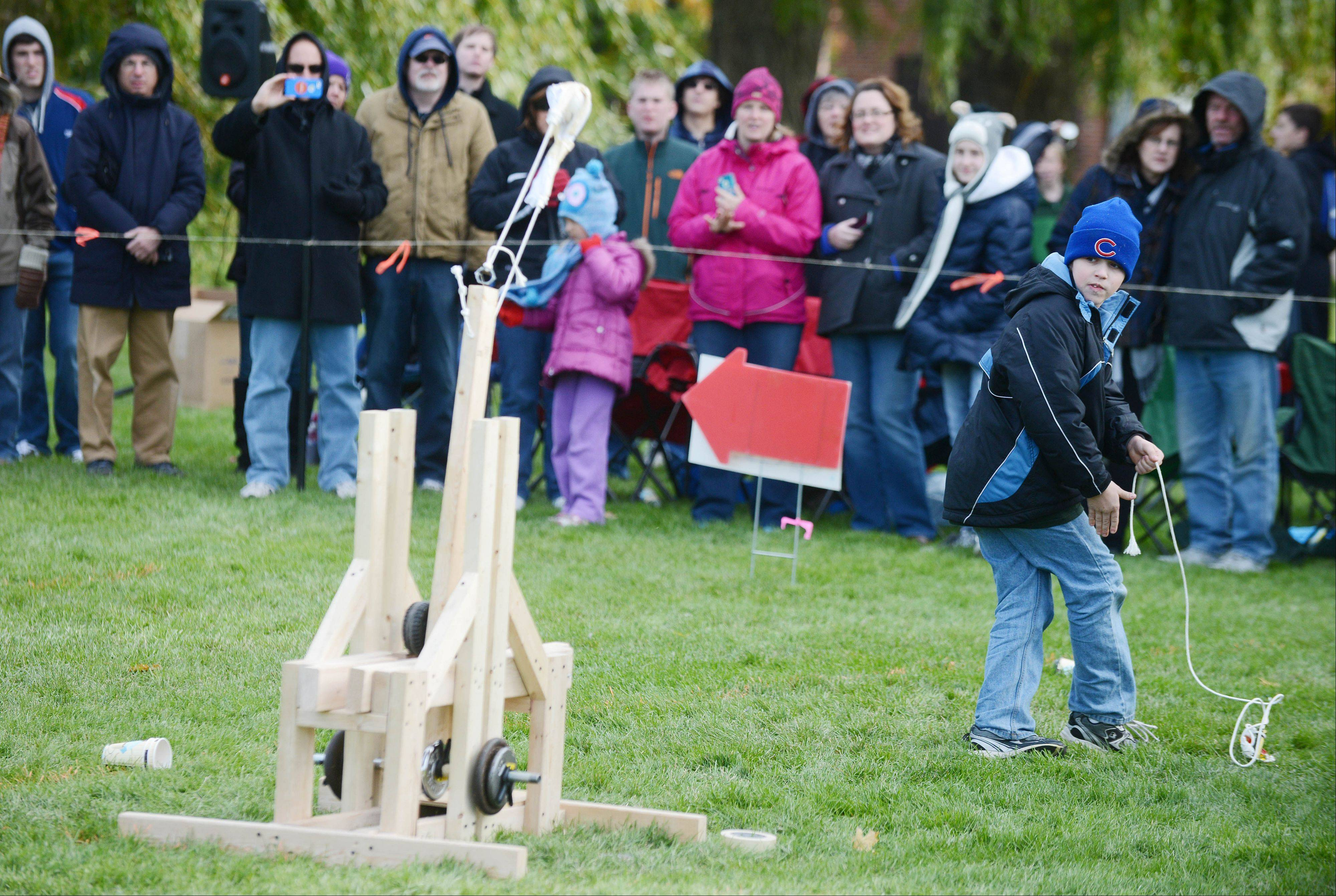 Steven Skulemowski, 11, of Chicago Ridge shoots his catapult during a contest Saturday morning at Cantigny Park in Wheaton. Nineteen teams competed.
