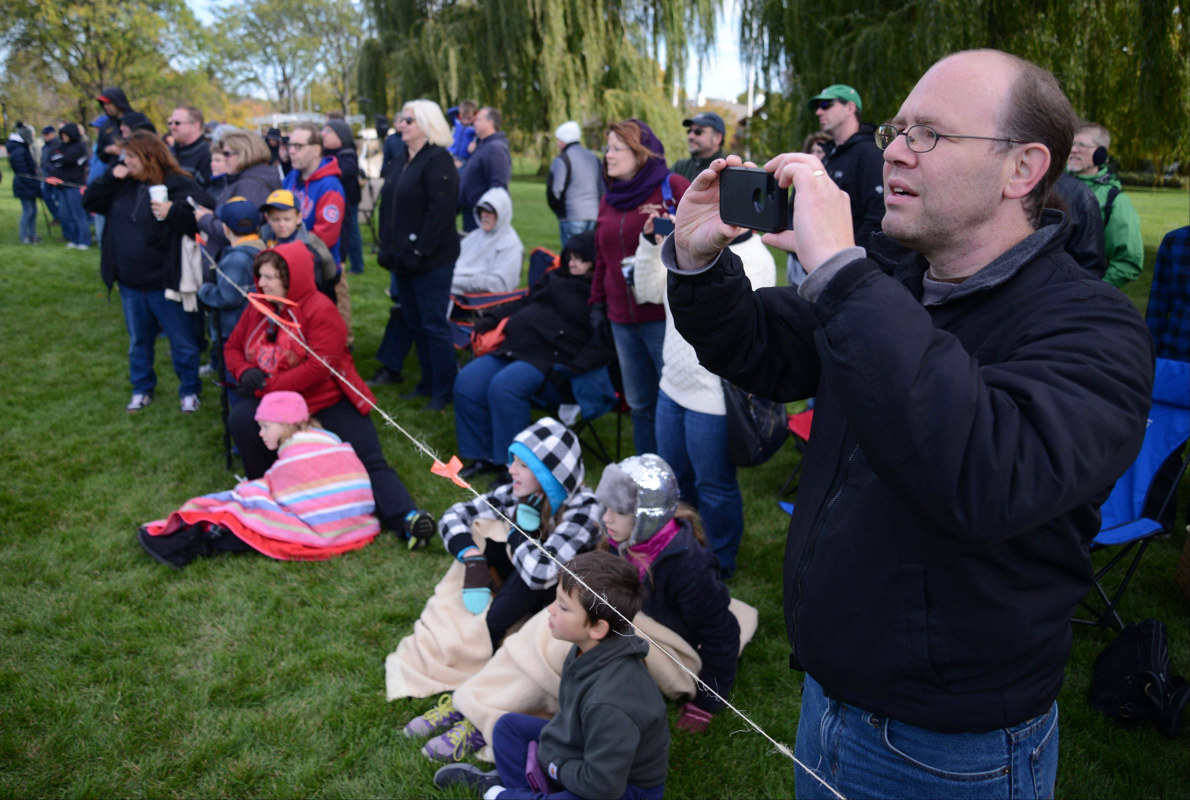 Ken Biggs of Hanover Park shoots some video of the catapult contest held Saturday morning at Cantigny Park in Wheaton. Well over 100 spectators came to watch.