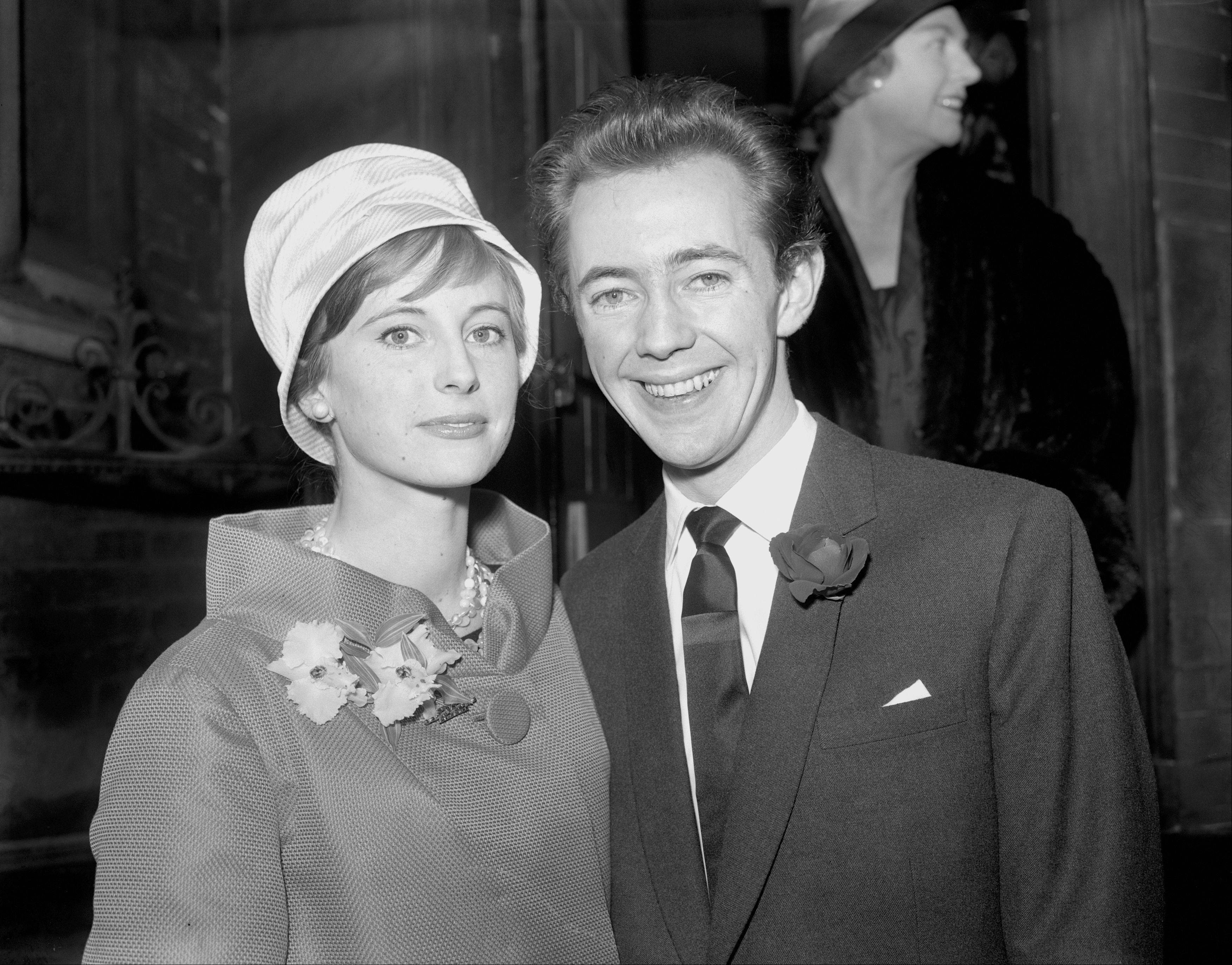 British actor and musician Noel Harrison, and his bride, Sara Tufnell, at the register office after their wedding at Caxton Hall, Westminster, London.