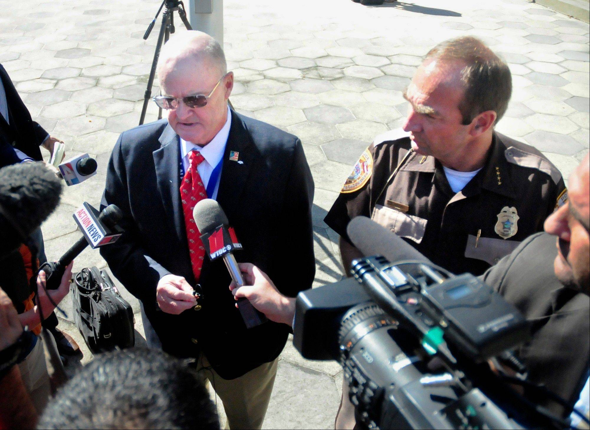Special Assistant District Attorney John B. Johnson, left, and Glynn County Police Chief Matt Doering meet with members of the press Friday in front of the Glynn County Courthouse in Brunswick, Ga.