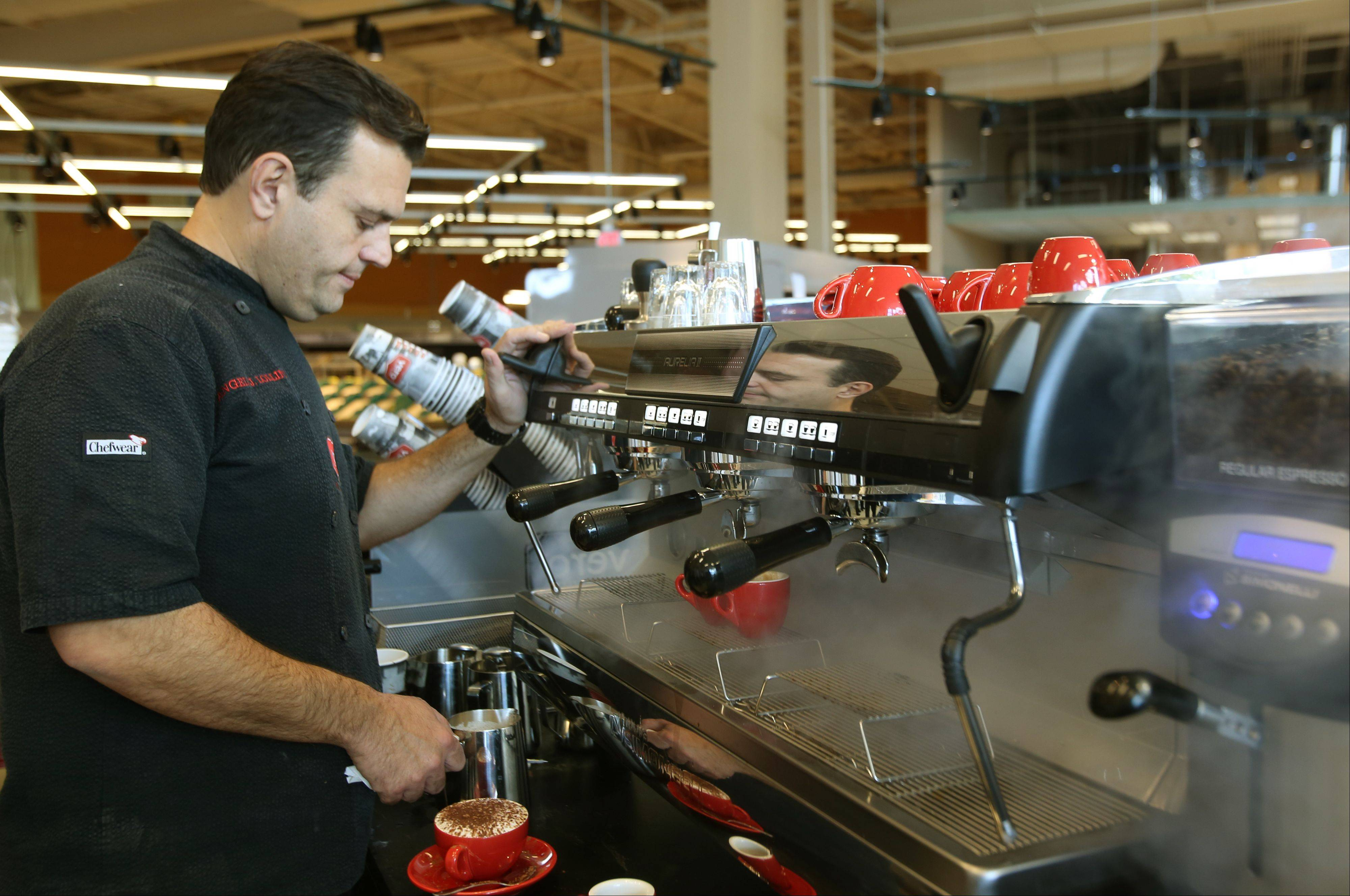 Angelo Lollino, director of Vero Coffee & Gelato, prepares for Tuesday's grand opening.