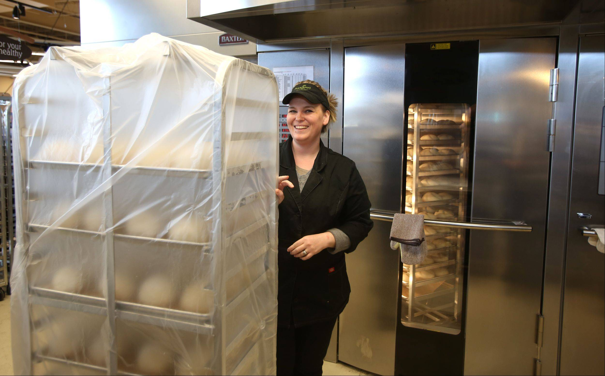 Melanie DeKeyrel Bell moves dough in preparation for Tuesday's grand opening of the Mariano's Fresh Market in Wheaton.