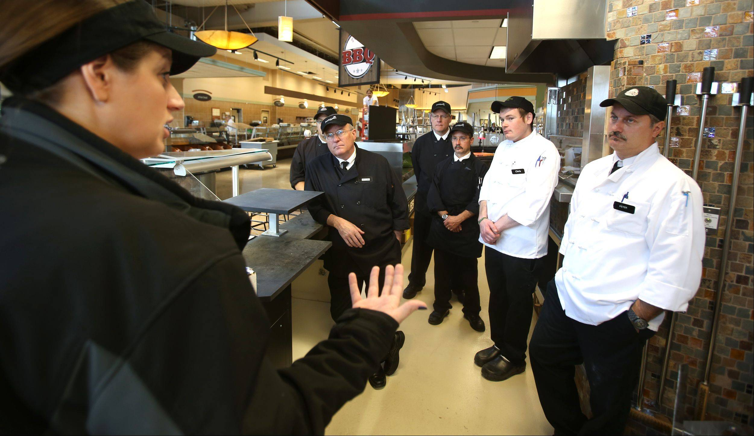 Mary Hess, food safety manager, talks to members of the hot foods department in preparation for Tuesday's grand opening of the Mariano's Fresh Market in Wheaton.