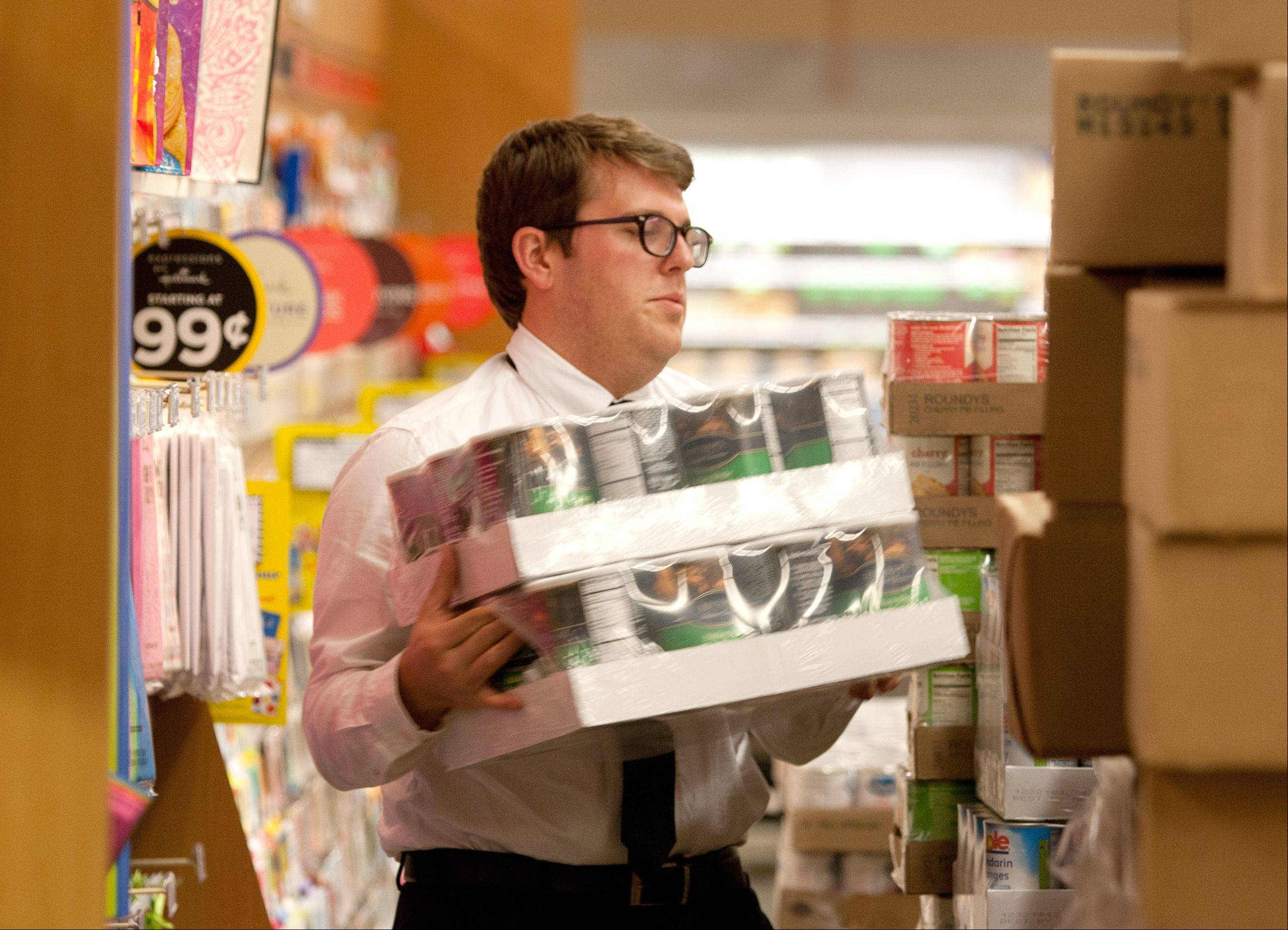 Patrick Whelan stacks canned products at Mariano's.