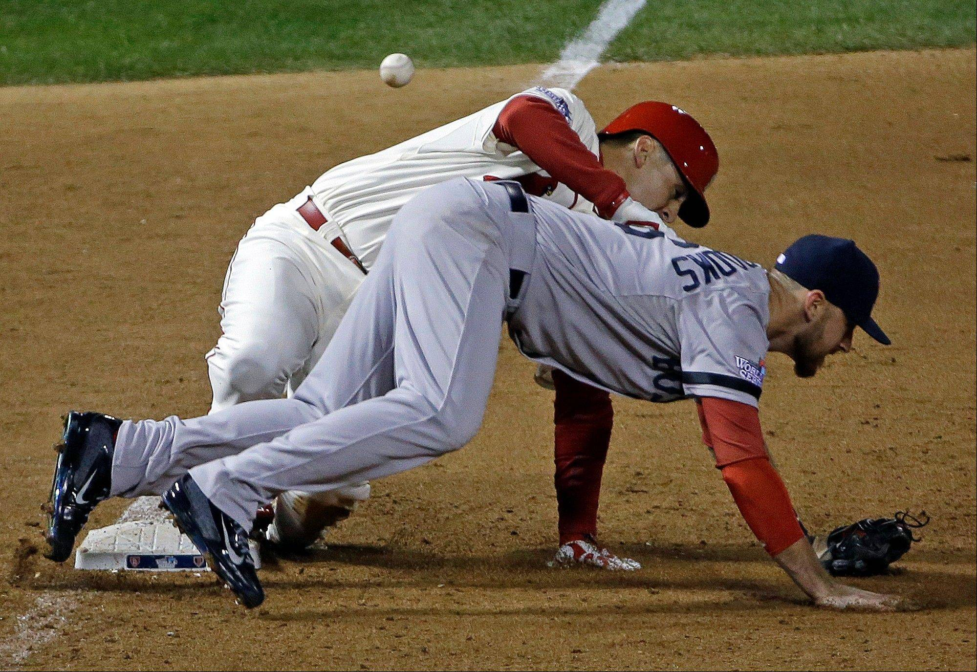 St. Louis Cardinals' Allen Craig gets tangled with Boston Red Sox's Will Middlebrooks during the ninth inning of Game 3. Middlebrooks was called for obstruction on the play and Craig went in to score the game-winning run.
